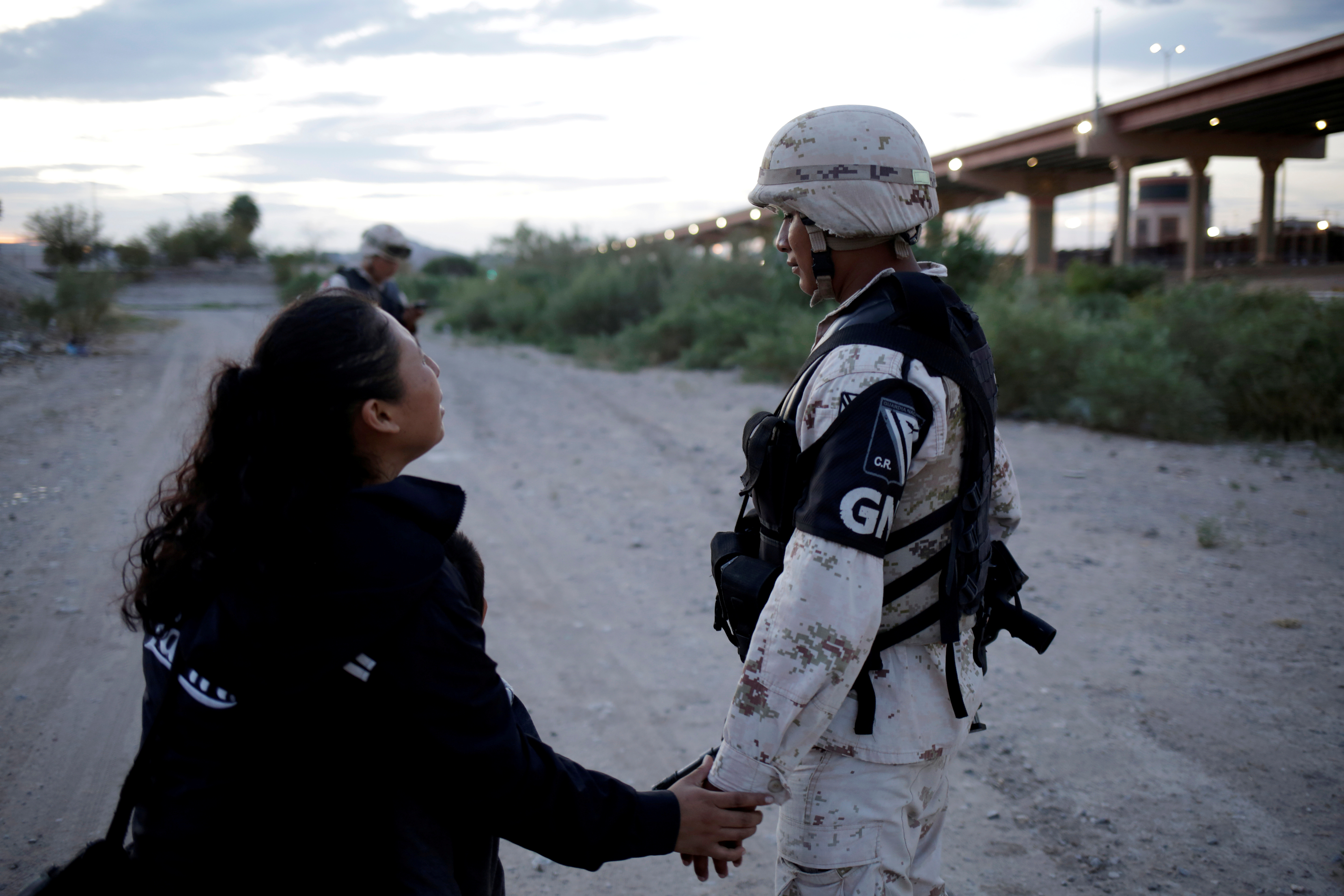 Guatemalan migrant Ledy Perez asks a member of the Mexican National Guard to let her cross with her son Anthony (not pictured) into the United States, as seen from Ciudad Juarez, Mexico July 22, 2019. REUTERS/Jose Luis Gonzalez