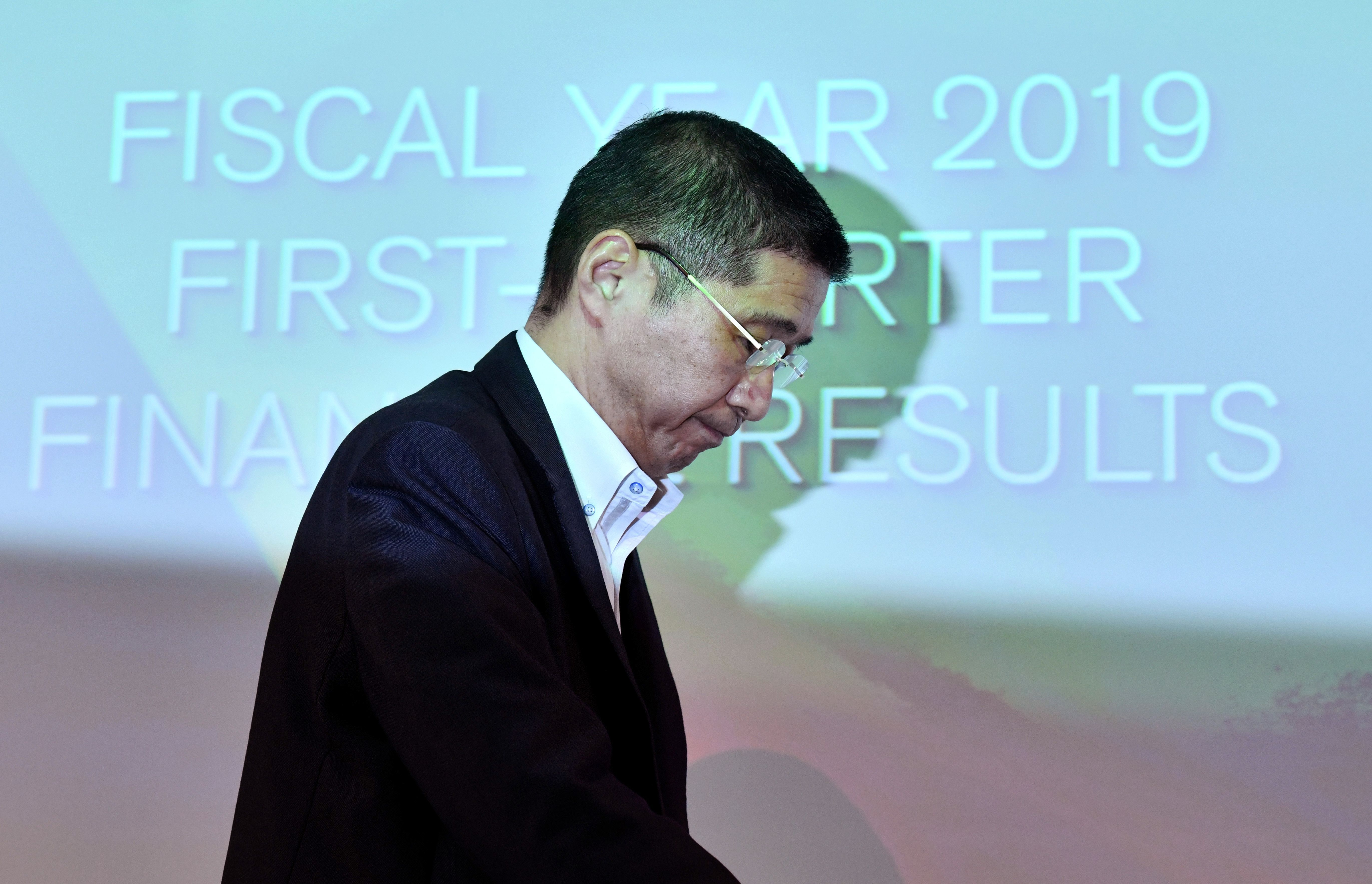 Nissan Motors president and CEO Hiroto Saikawa leaves a press conference after announcing first quarter financial results at the company headquarters in Yokohama on July 25, 2019. - Crisis-hit Japanese automaker Nissan said its net profit plunged nearly 95 percent in the first quarter due to slumping sales and growing costs. (Photo by TOSHIFUMI KITAMURA/AFP/Getty Images)