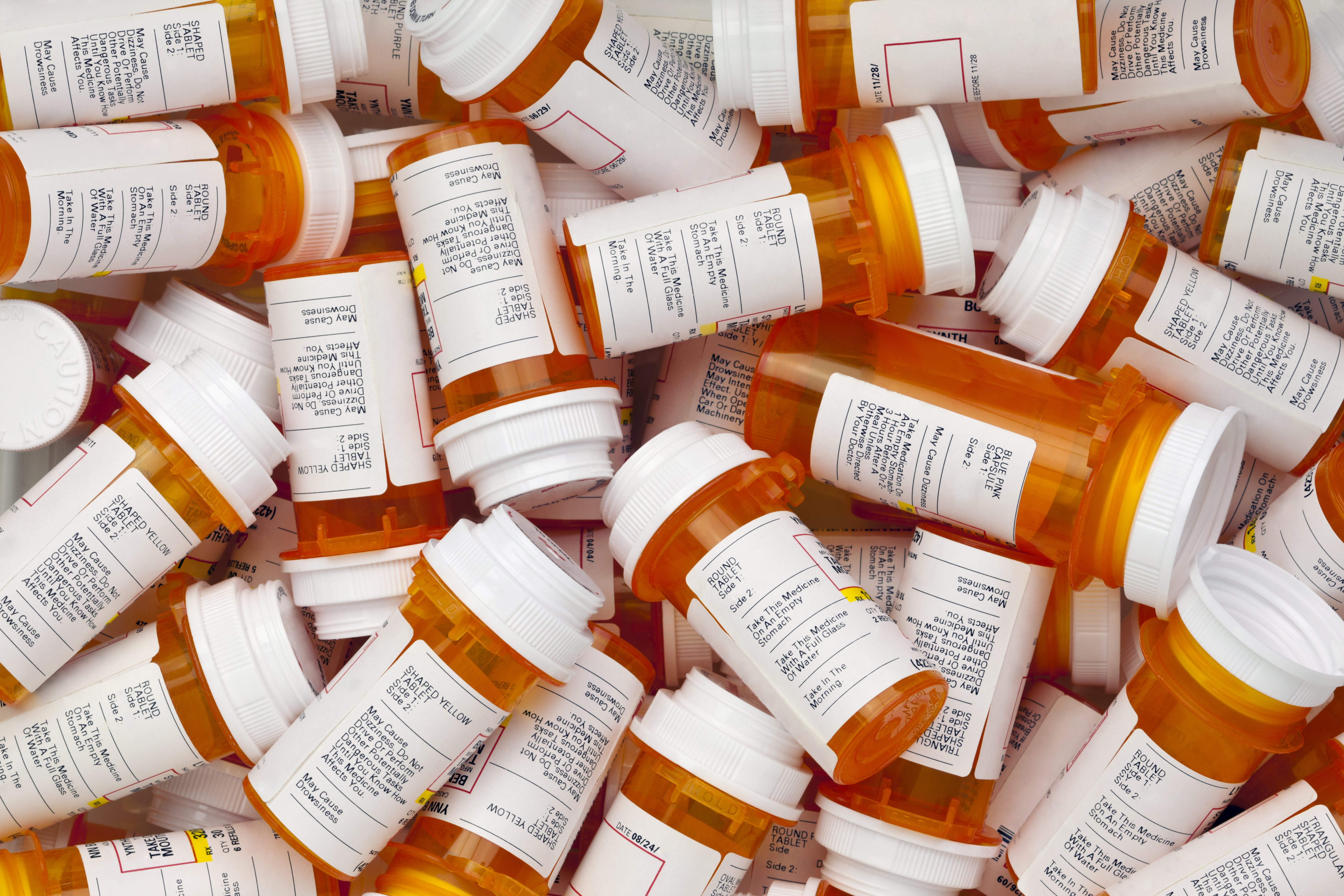Prescription bottles are in a jumble. Shutterstock image via David Smart