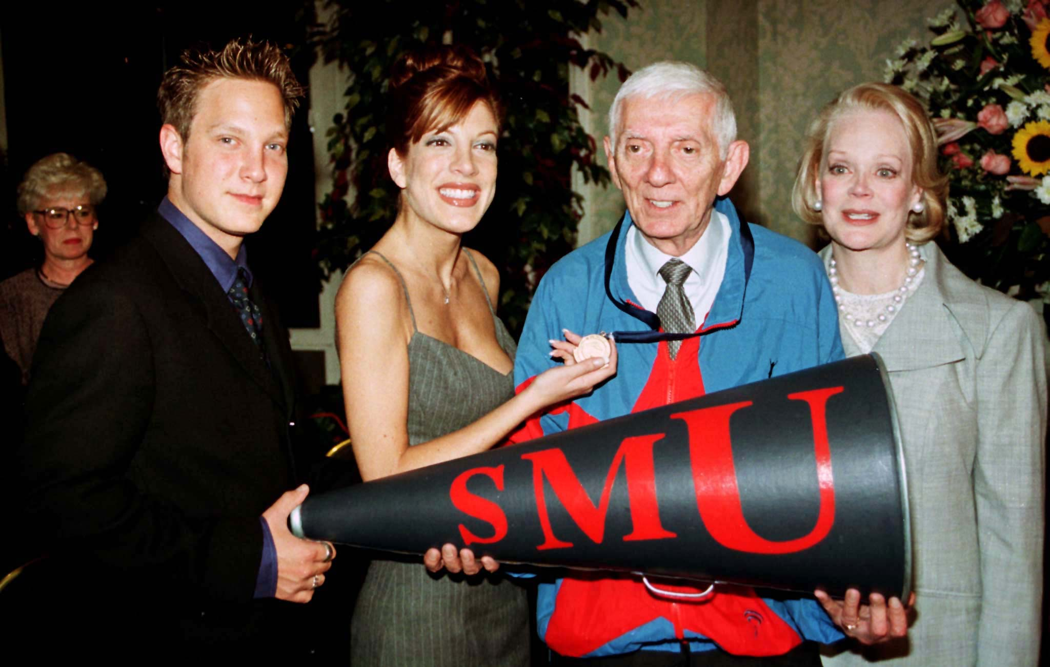 "Randy Spelling, Tori Spelling, Aaron Spelling, and Candy Spelling pose together after Aaron received the ""Distinguished Alumni Award"" from Southern Methodist University October 8, 1988 in Beverly Hills, California. Photo by Reuters."