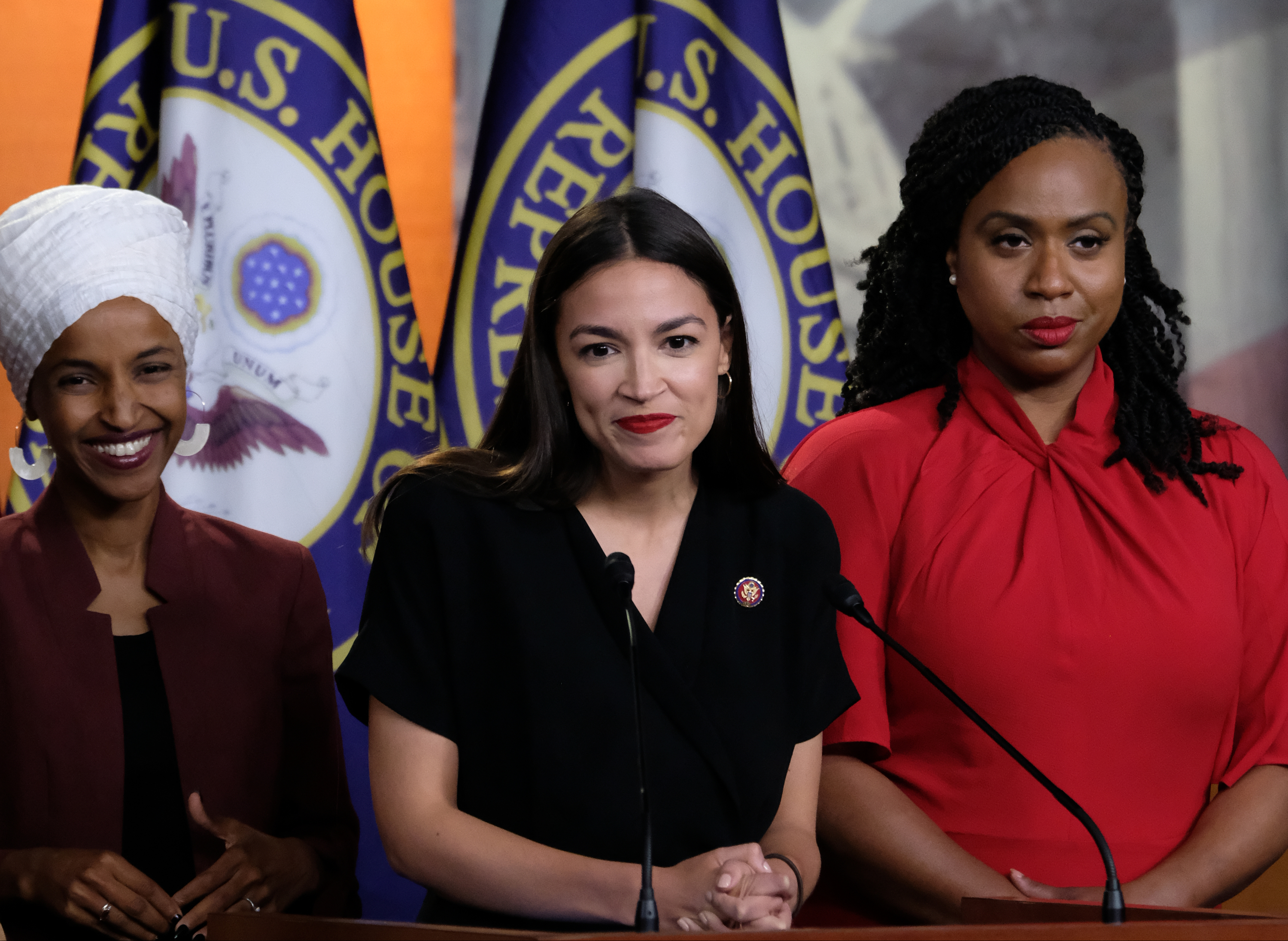 """WASHINGTON, DC - JULY 15: U.S. Rep. Alexandria Ocasio-Cortez (D-NY) pauses while speaking as Reps. Ilhan Omar (D-MN) and Ayanna Pressley (D-MA) listen during a news conference at the U.S. Capitol on July 15, 2019 in Washington, DC. President Donald Trump stepped up his attacks on the four progressive Democratic congresswomen, saying that if they're not happy in the U.S. """"they can leave."""" (Photo by Alex Wroblewski/Getty Images)"""