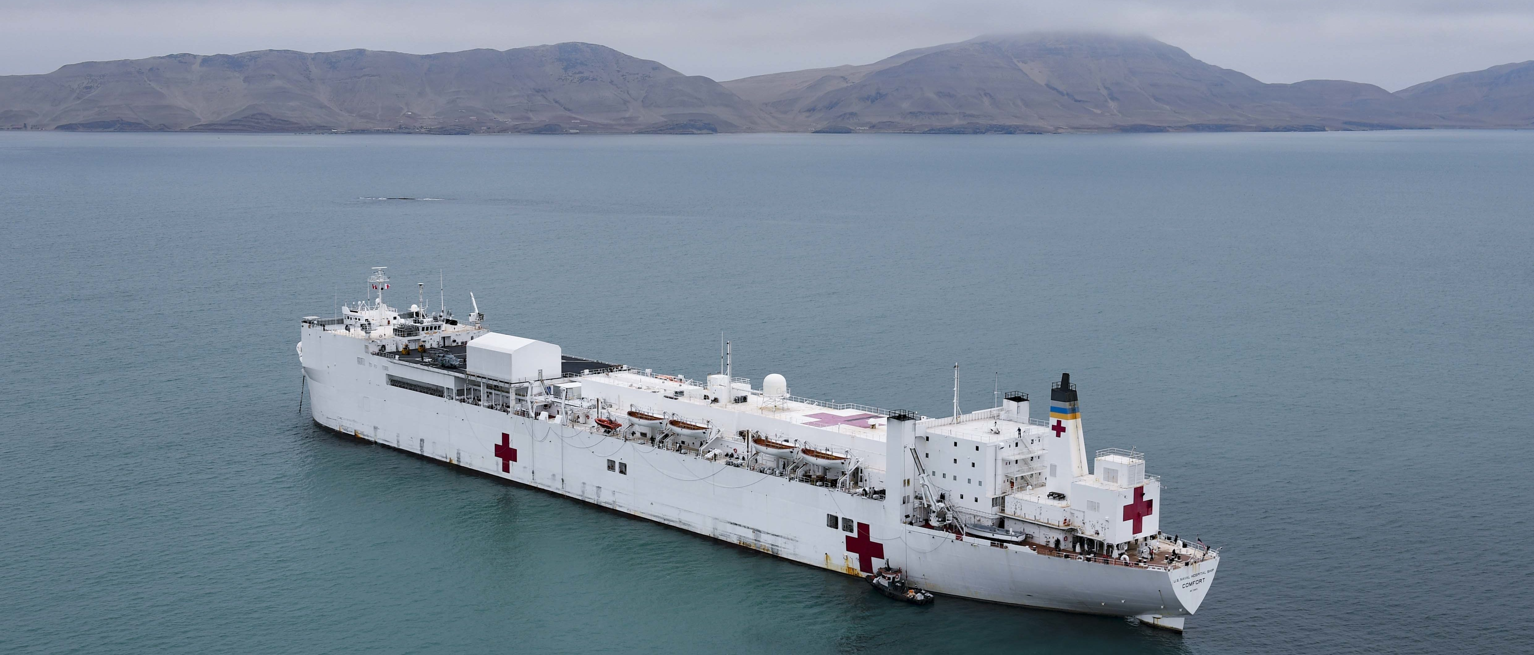 The hospital ship USNS Comfort (T-AH 20) is anchored off the coast of Callao, Peru, on July 8, 2019. (U.S. Navy photo by Mass Communication Specialist 2nd Class Morgan K. Nall)