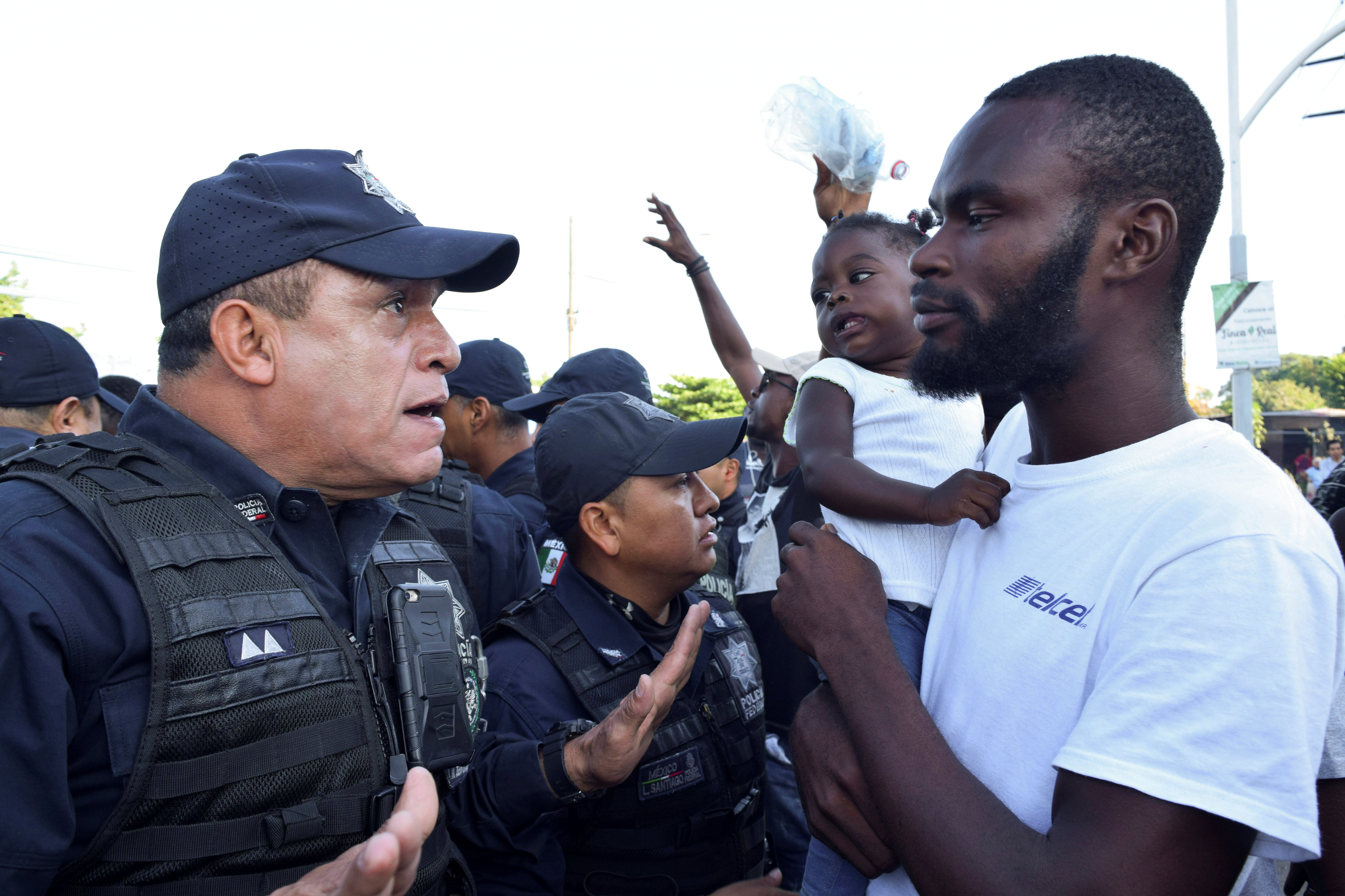 Migrants from Haiti and Africa protest outside the Siglo XXI immigrant detention center in Tapachula