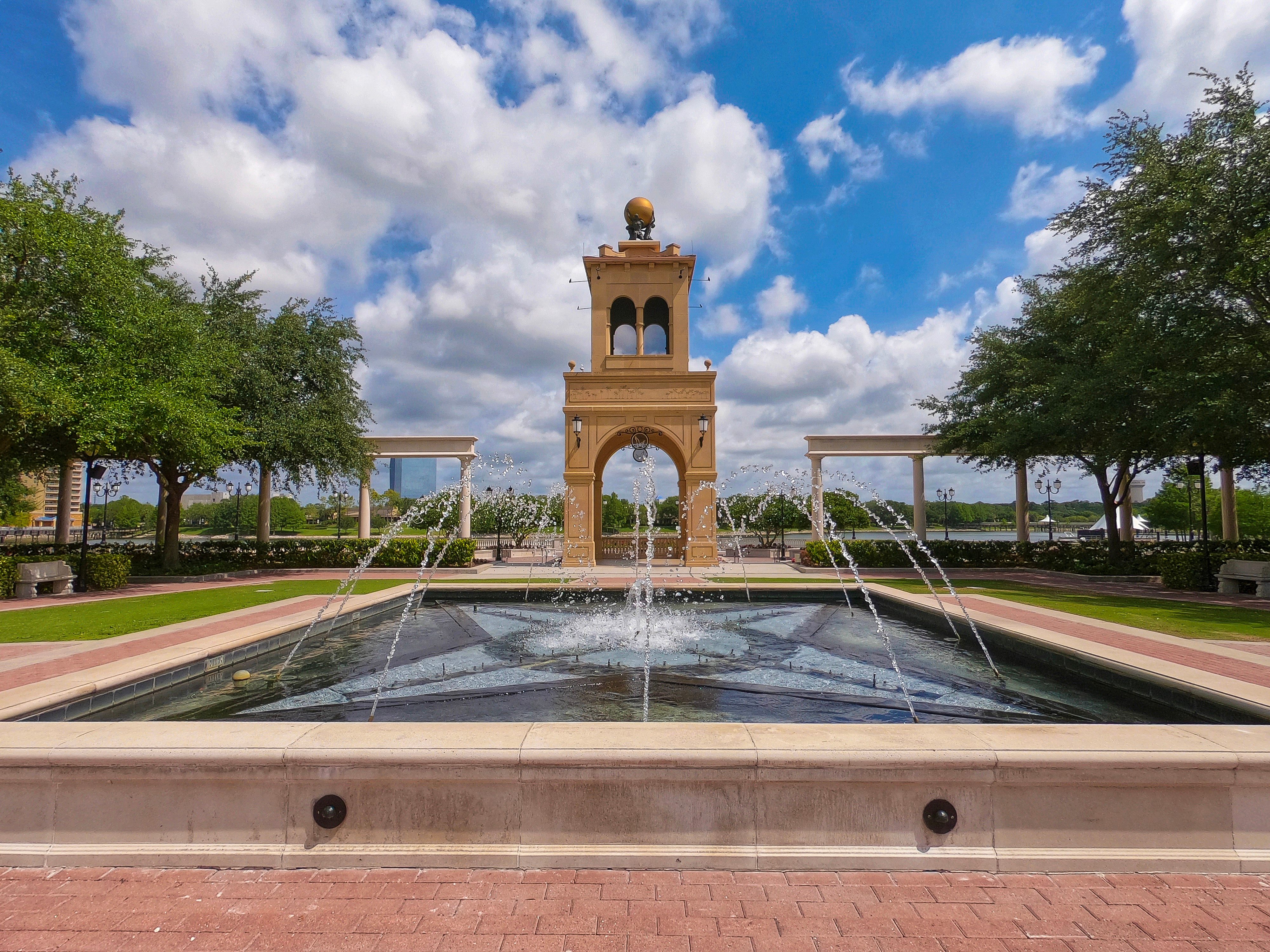 Altamonte Springs, Florida USA - May 9, 2019 - Cranes Roost Park fountain and tower in the background. Brittx, Shutterstock