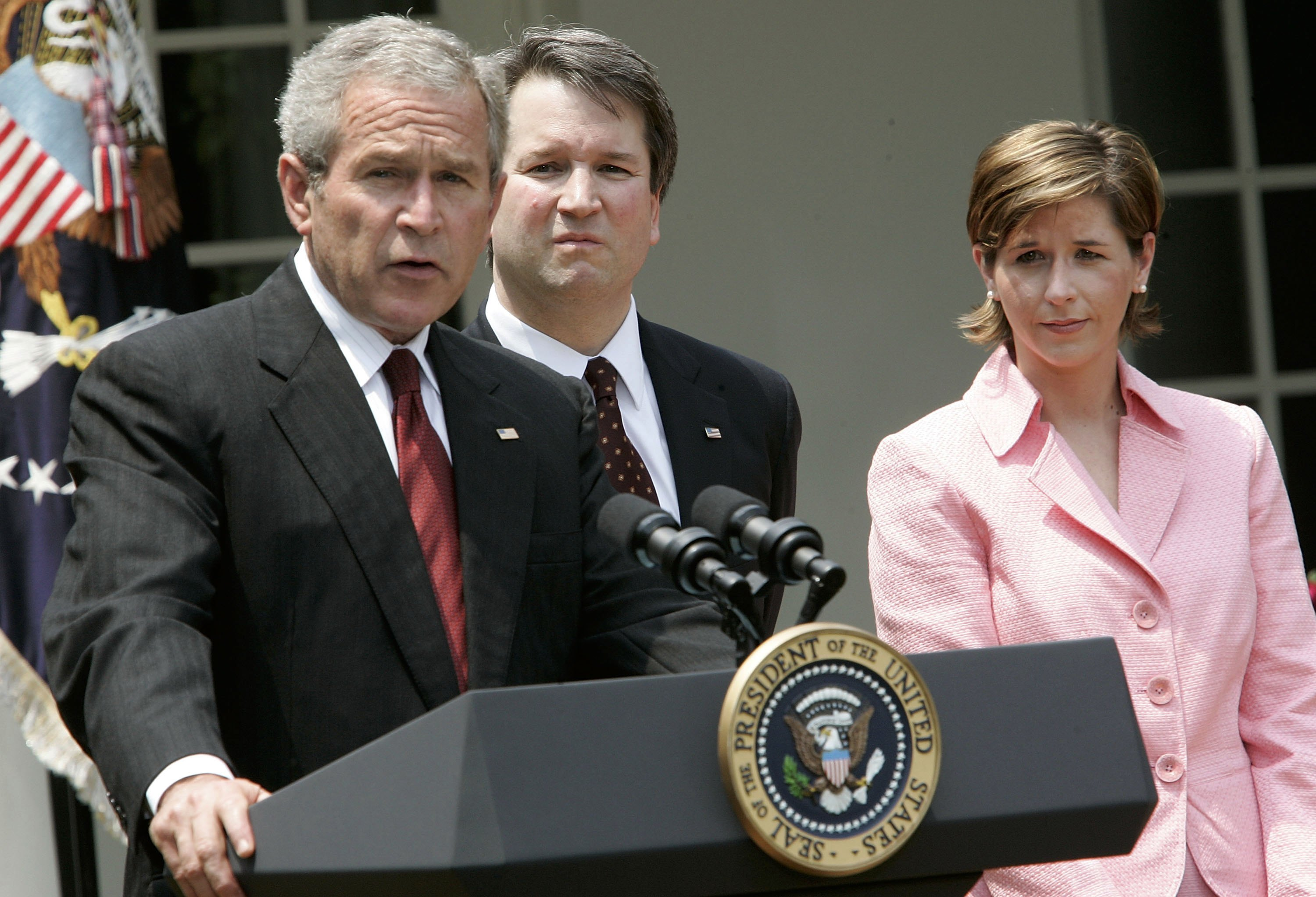 President George W. Bush speaks at a Rose Garden ceremony as Brett and Ashley Kavanaugh look on in June 2006. (Alex Wong/Getty Images)
