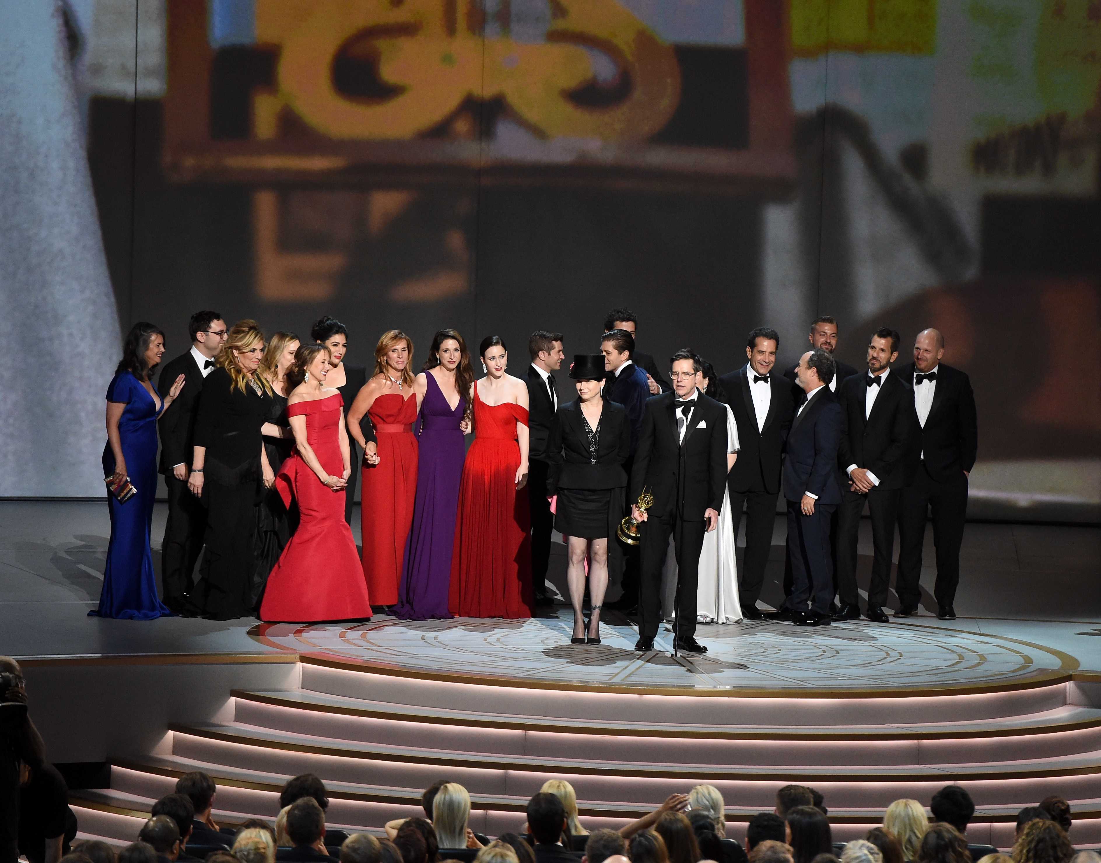 Amy Sherman-Palladino (front center L) and Daniel Palladino (front center R) and cast and crew accept the Outstanding Comedy Series award for 'The Marvelous Mrs. Maisel' onstage during the 70th Emmy Awards at Microsoft Theater on September 17, 2018 in Los Angeles, California. (Photo by Kevin Winter/Getty Images)