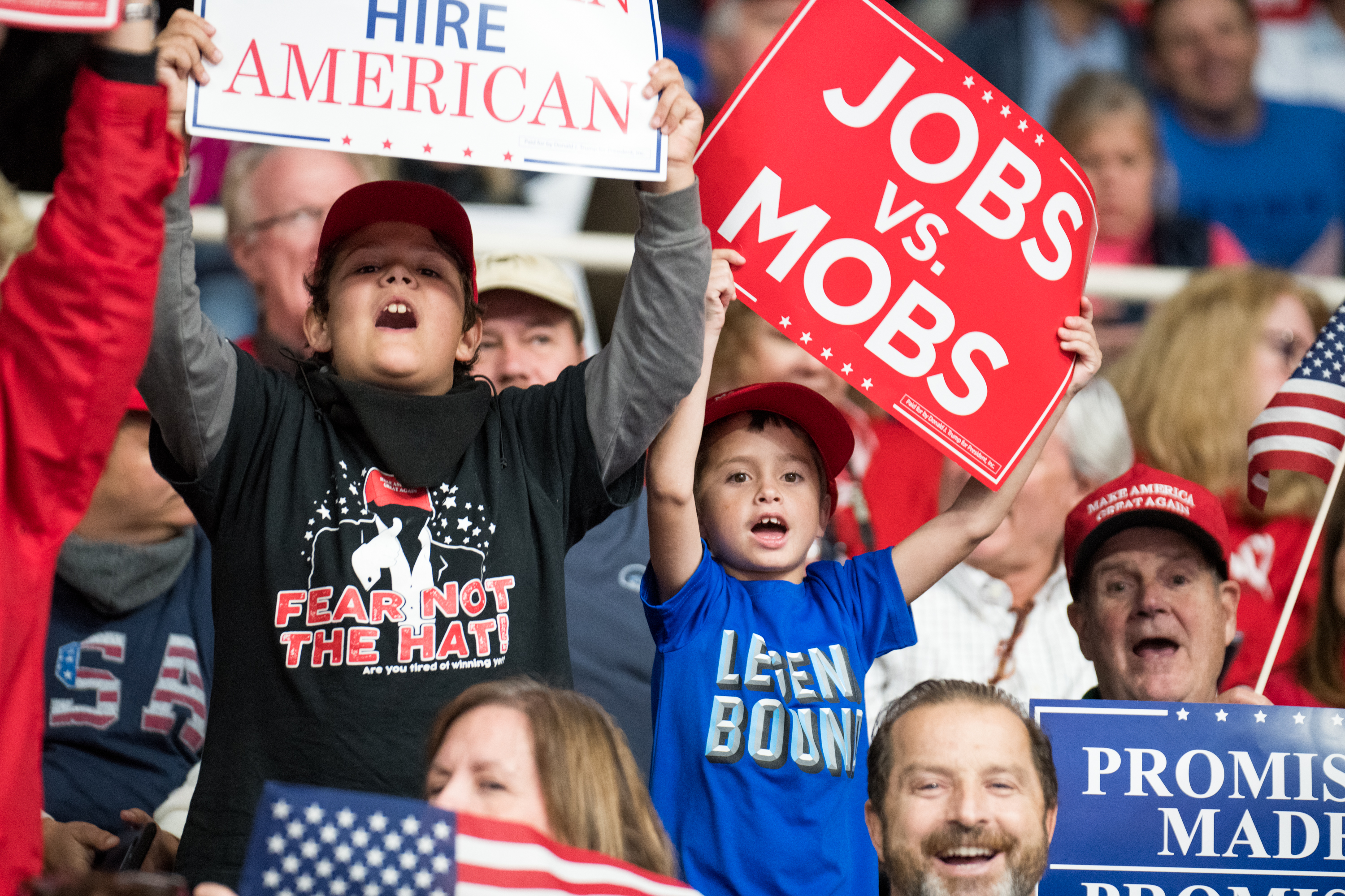 Supporters of President Donald Trump cheer while waiting for the president's arrival before a campaign rally at the Bojangles Coliseum on October 26, 2018 in Charlotte, North Carolina. President Trump visited Charlotte to campaign for 9th District House candidate Mark Harris. (Photo by Sean Rayford/Getty Images)