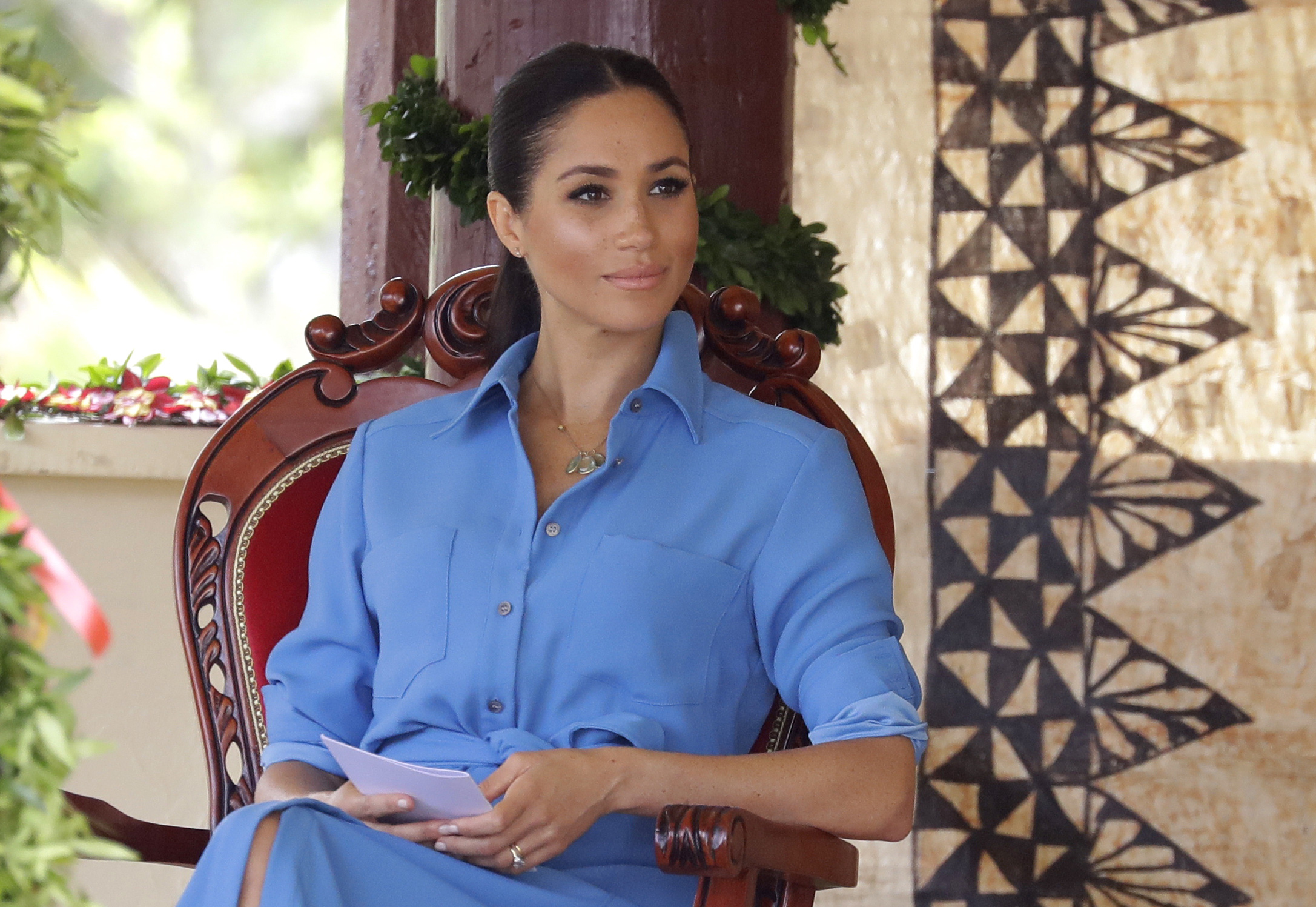 Meghan, Duchess of Sussex talks with students during a visit to Tupou College in Tonga on October 26, 2018. (Photo by Kirsty Wigglesworth - Pool/Getty Images)