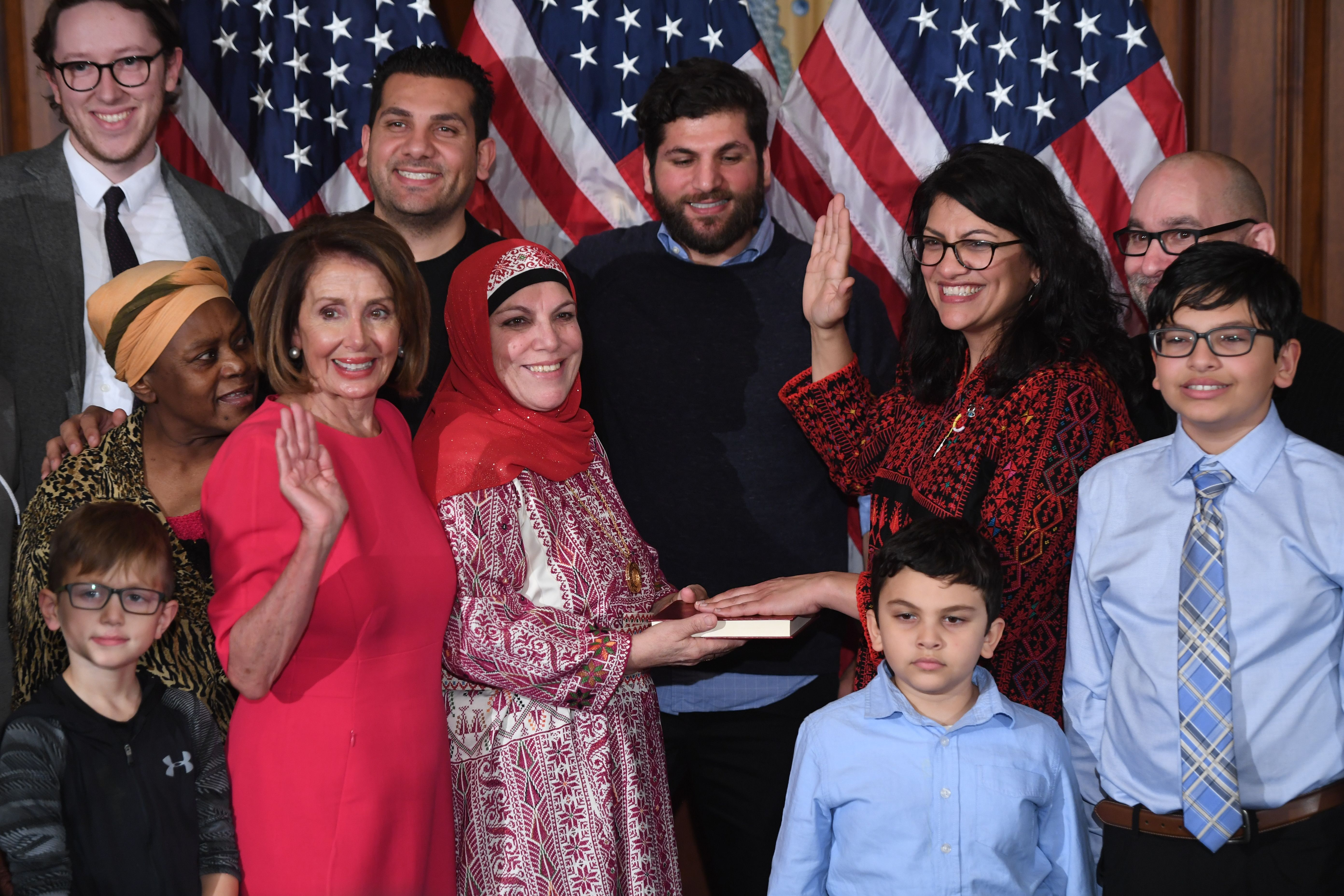 Representative Rashida Tlaib participates in a ceremonial swearing-in from Speaker of the House Nancy Pelosi at the start of the 116th Congress at the US Capitol in Washington, DC, January 3, 2019. (SAUL LOEB/AFP/Getty Images)
