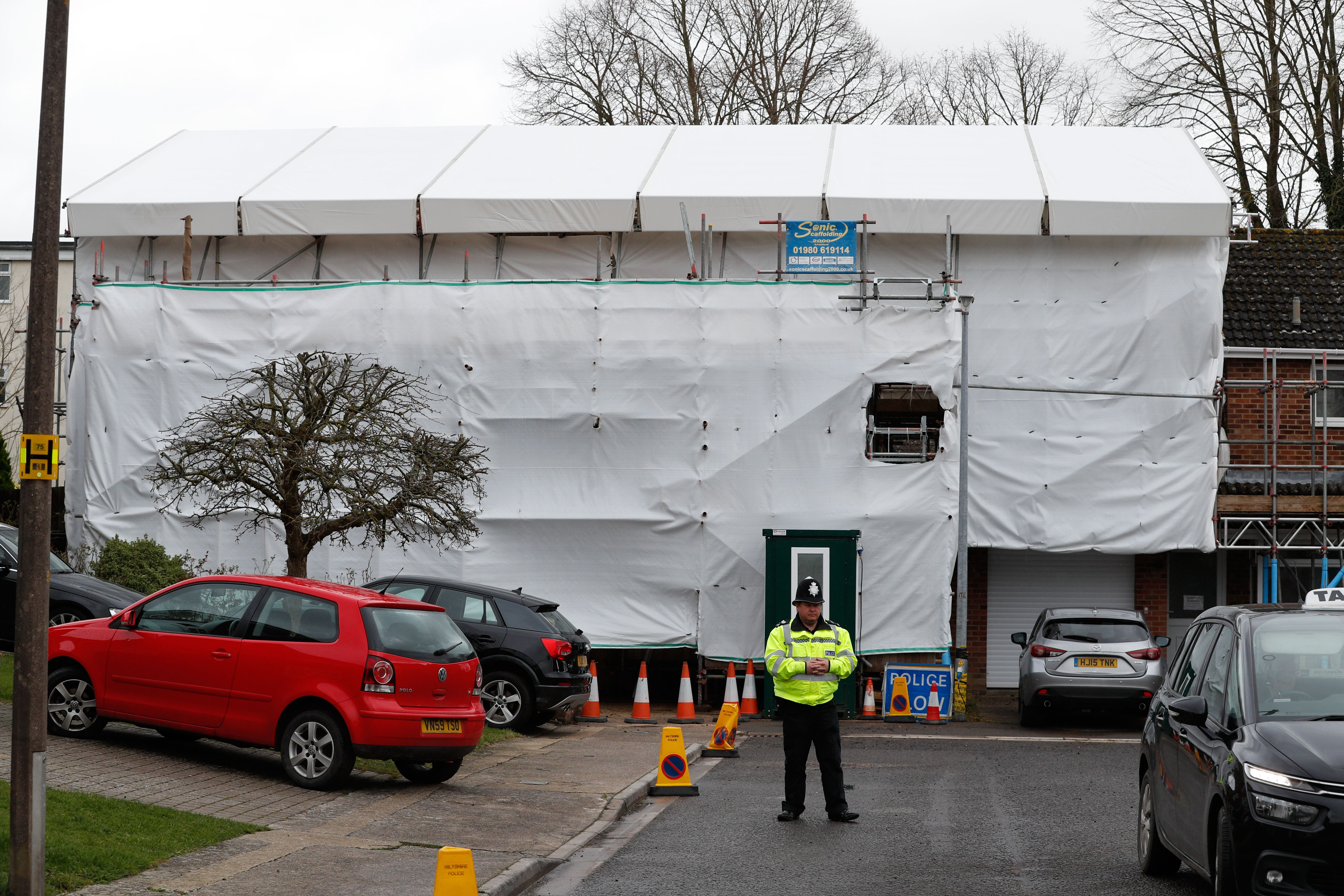 A pictures shows covered tarpaulin and scaffolding and secured by police the former home of Russian ex-spy Sergei Skripal in Salisbury, southern England on March 4, 2019 exactly one year to the day since the assissination attempt on Skripal with the nerve agent Novichok that seriously injured him and his daughter Yulia. (Photo credit should read ADRIAN DENNIS/AFP/Getty Images)