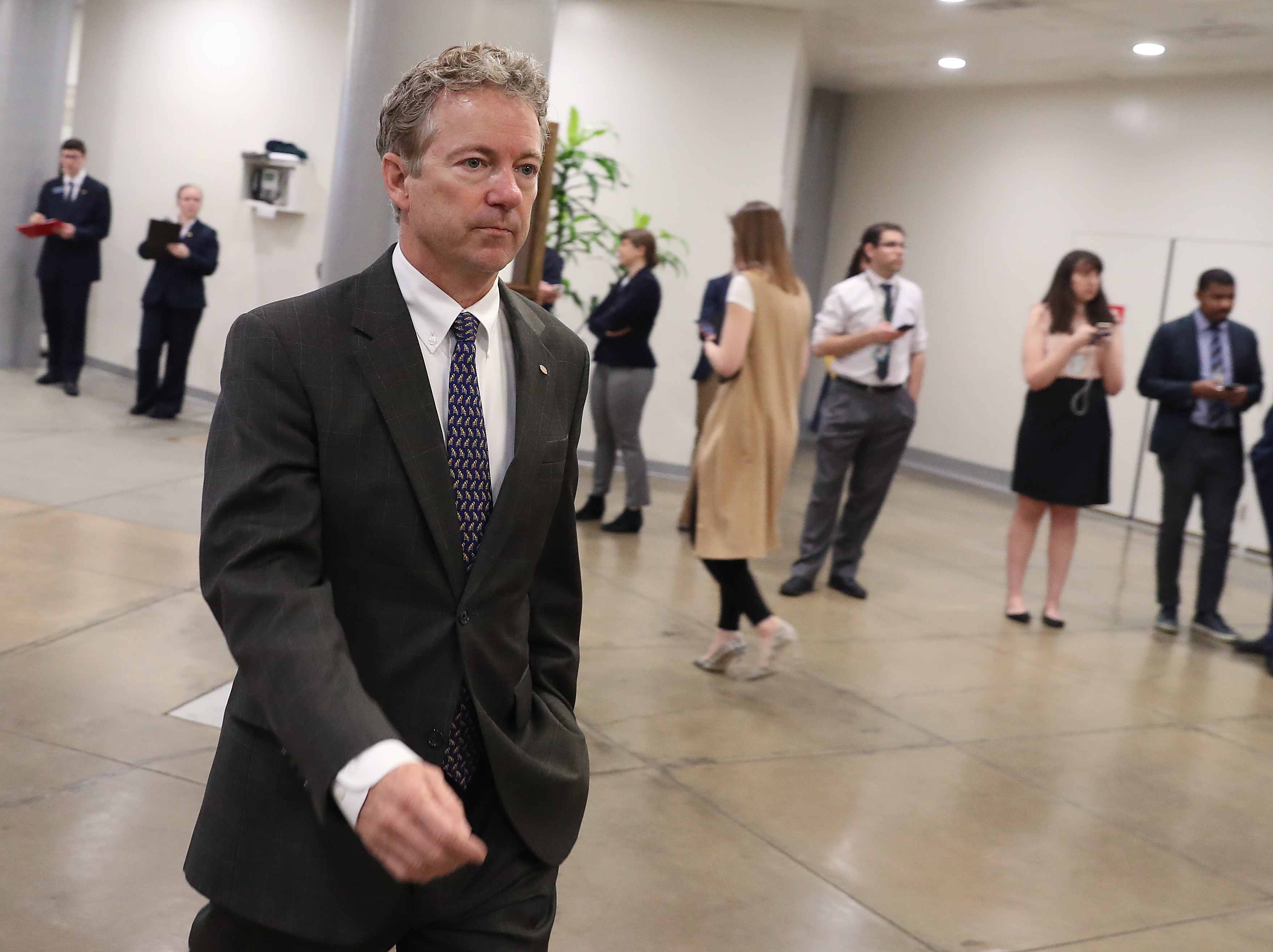 Sen. Rand Paul walks through the U.S. Capitol prior to the Senate voting to overturn the President's national emergency border declaration, at the U.S. Capitol on March 14, 2019 in Washington, DC. (Photo by Mark Wilson/Getty Images)