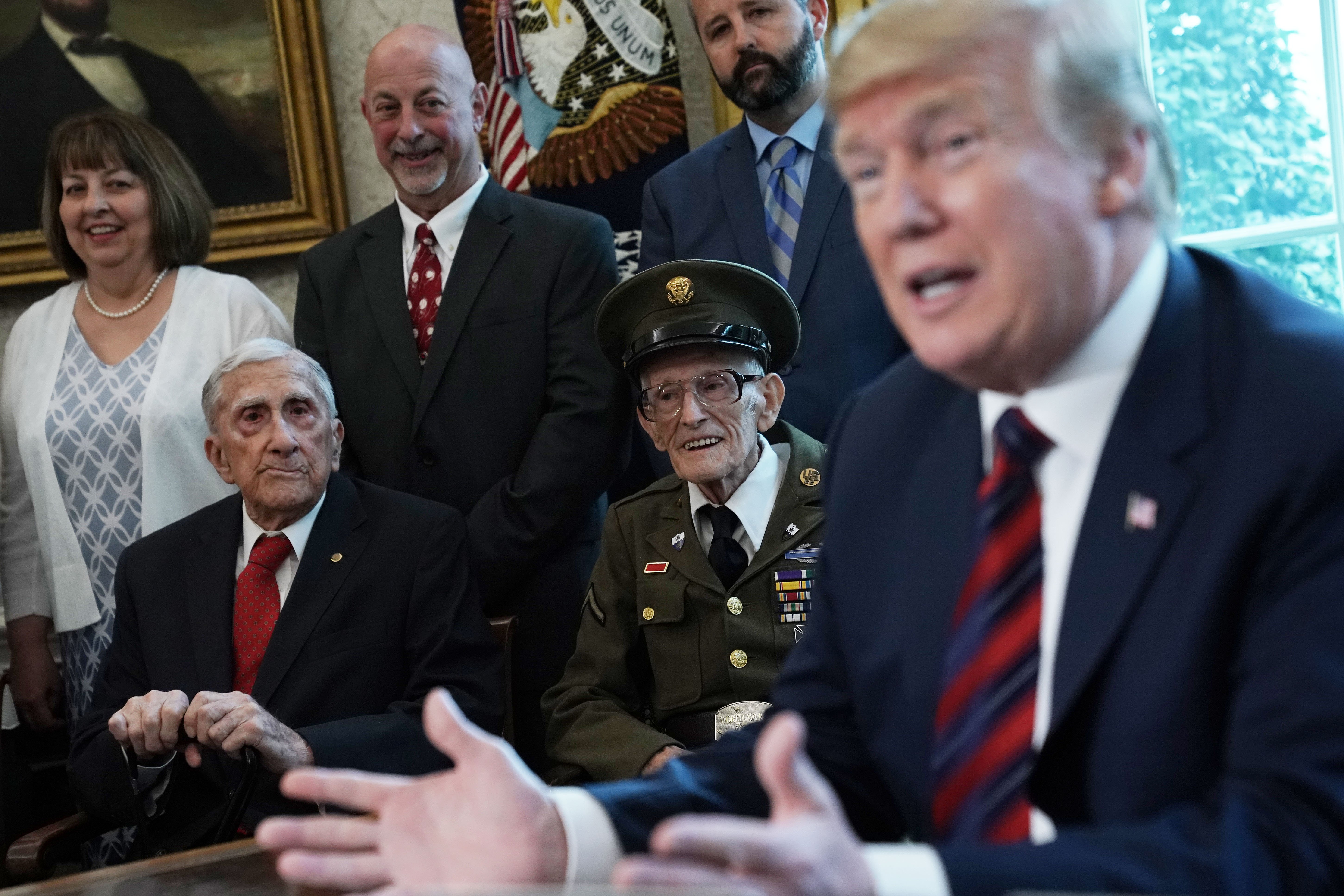 U.S. President Donald Trump speaks as he meets with World War II veterans including Paul Kriner (2nd L) and Floyd Wigfield (3rd L) in the Oval Office of the White House April 11, 2019 in Washington, DC. President Trump hosted the veterans and their families to honor their service during WWII. (Photo by Alex Wong/Getty Images)