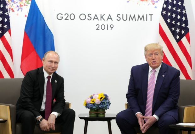 Russian President Vladimir Putin and US President Donald Trump hold a meeting on the sidelines of the G20 summit in Osaka on June 28, 2019. (Photo by MIKHAIL KLIMENTYEV/AFP/Getty Images)