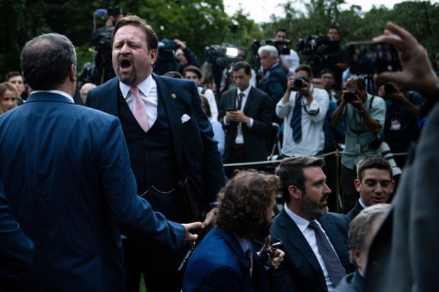 Playboy magazine contributor Brian Karem (L) and former Trump deputy assistant Sebastian Gorka (2ndL) argue after the US president delivered remarks on citizenship and the census at the White House in Washington, DC, on July 11, 2019. (BRENDAN SMIALOWSKI/AFP/Getty Images)