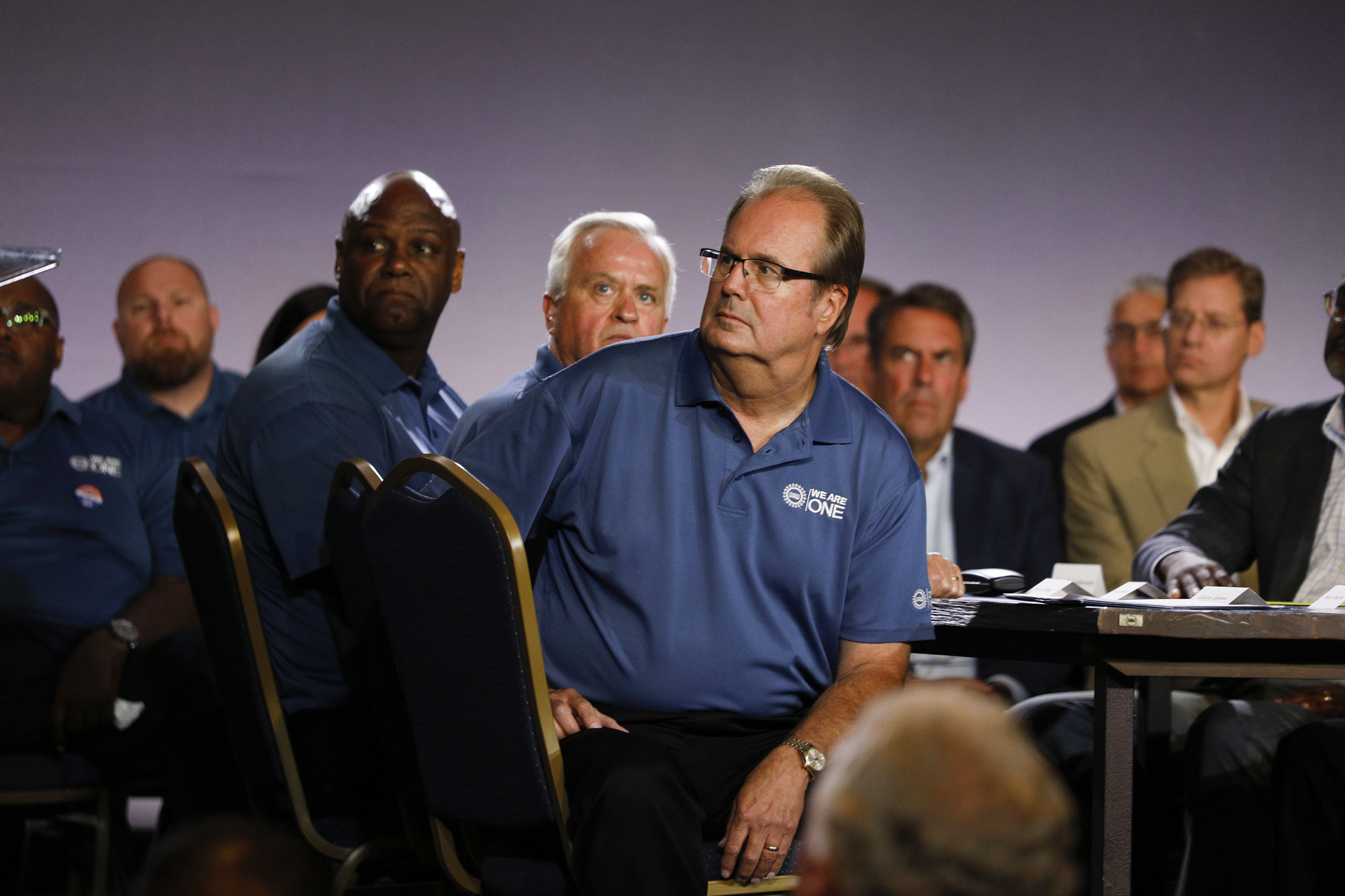 DETROIT, MI - JULY 16: United Auto Workers President Gary Jones listens to General Motors Chairman and CEO Mary Barra speak as they open the 2019 GM-UAW contract talks on July 16, 2019 in Detroit, Michigan. With its increasing investment in electric vehicles, GM is faced with the challenge of transitioning its employees to work with new technologies. (Photo by Bill Pugliano/Getty Images)