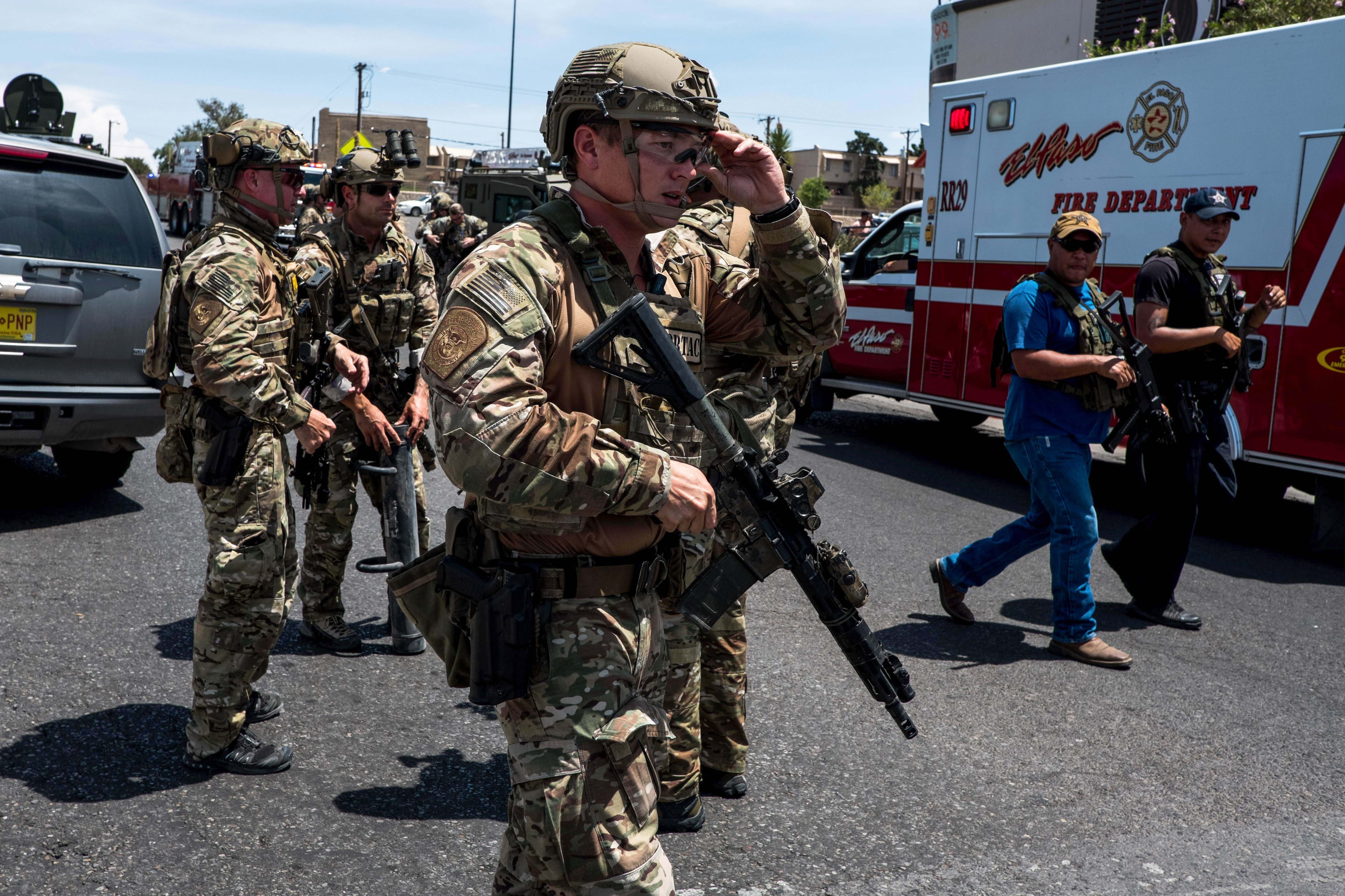 """Law enforcement agencies respond to an active shooter at a Wal-Mart near Cielo Vista Mall in El Paso, Texas, Saturday, Aug. 3, 2019. - Police said there may be more than one suspect involved in an active shooter situation Saturday in El Paso, Texas. City police said on Twitter they had received """"multi reports of multipe shooters."""" There was no immediate word on casualties. / JOEL ANGEL JUAREZ/AFP/Getty Images"""