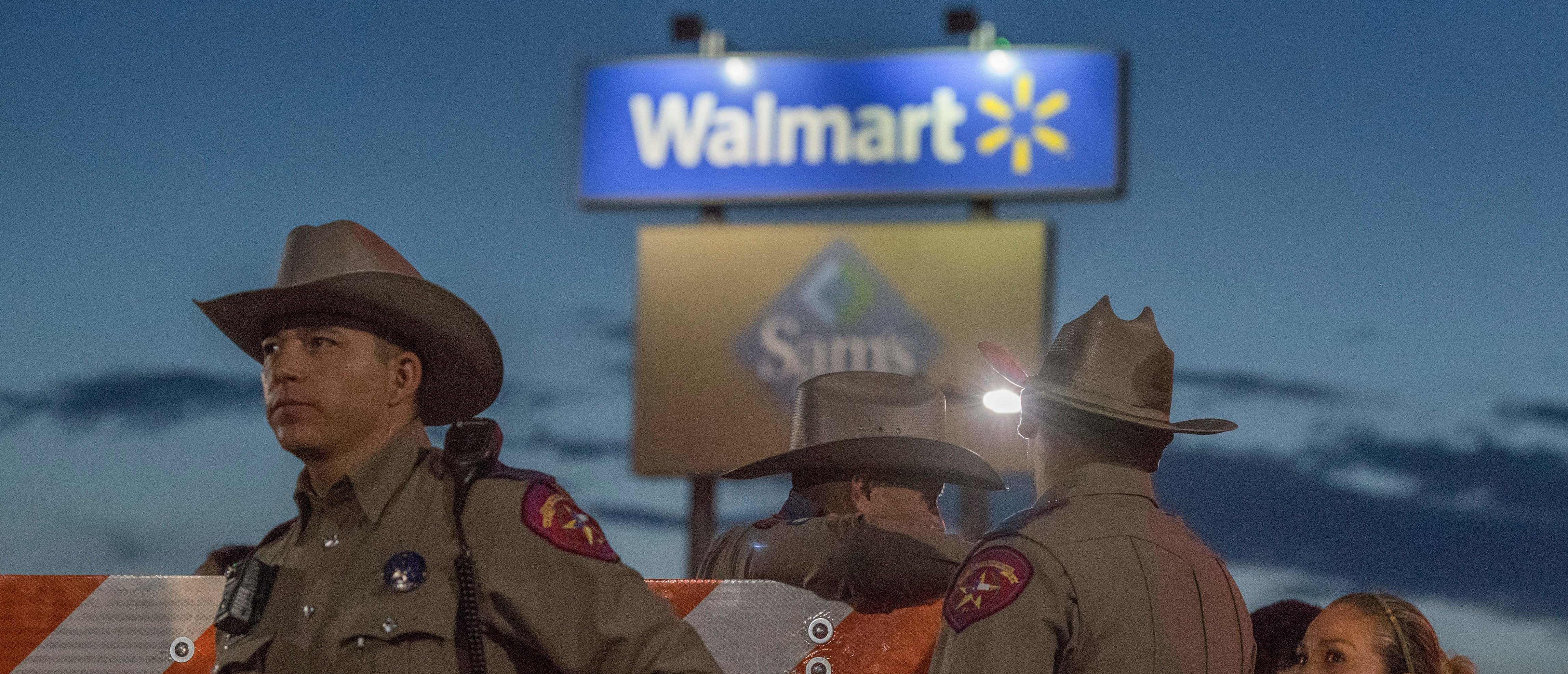 Texas State Troopers keep watch at the makeshift memorial for victims of the shooting that left a total of 22 people dead at the Cielo Vista Mall WalMart in El Paso, Texas, on August 6, 2019. (Photo credit should read MARK RALSTON/AFP/Getty Images)