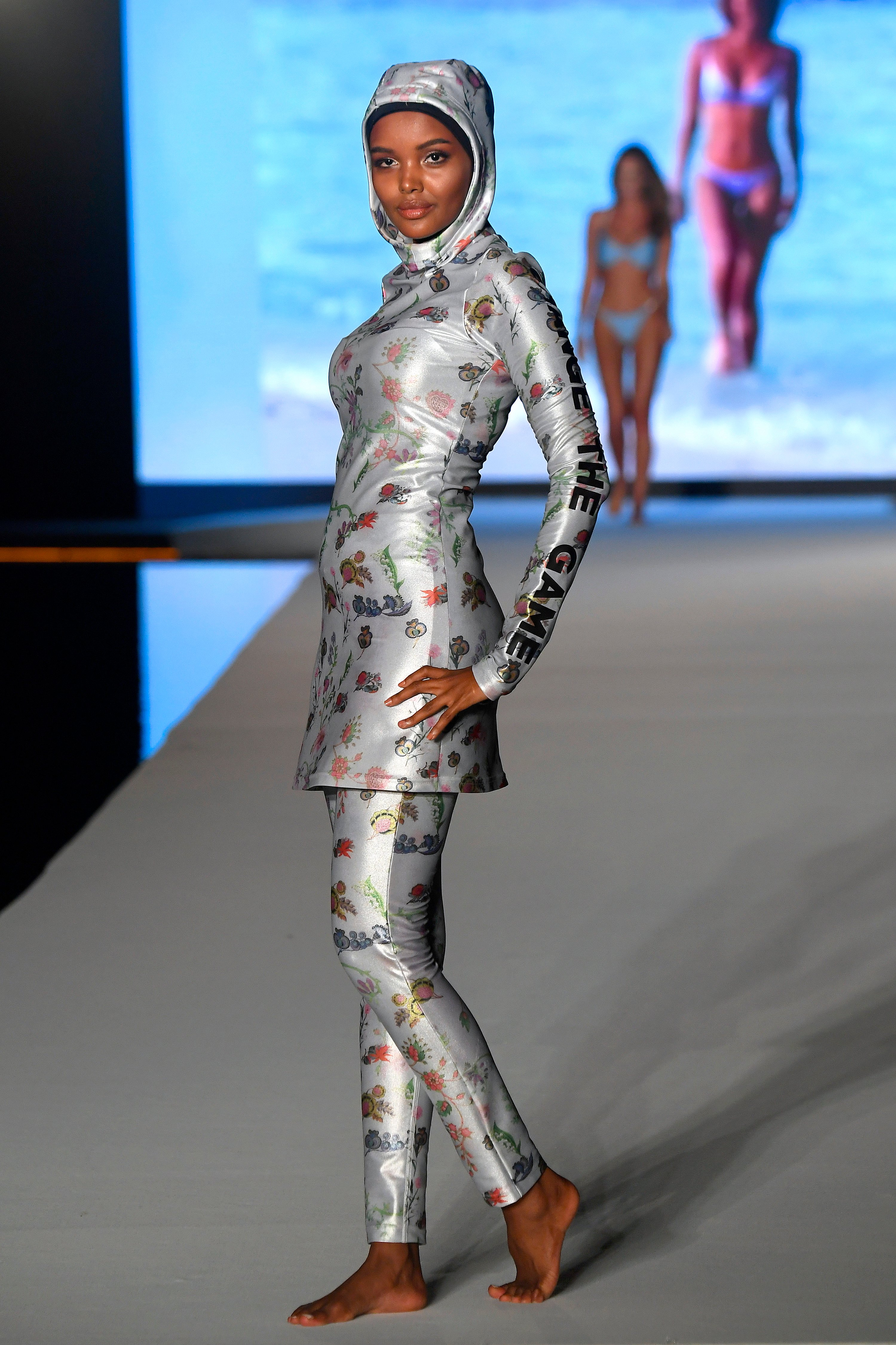 Halima Aden walks the runway during the 2019 Sports Illustrated Swimsuit Runway Show During Miami Swim Week At W South Beach on July 14, 2019 in Miami Beach, Florida. (Photo by Frazer Harrison/Getty Images for Sports Illustrated)