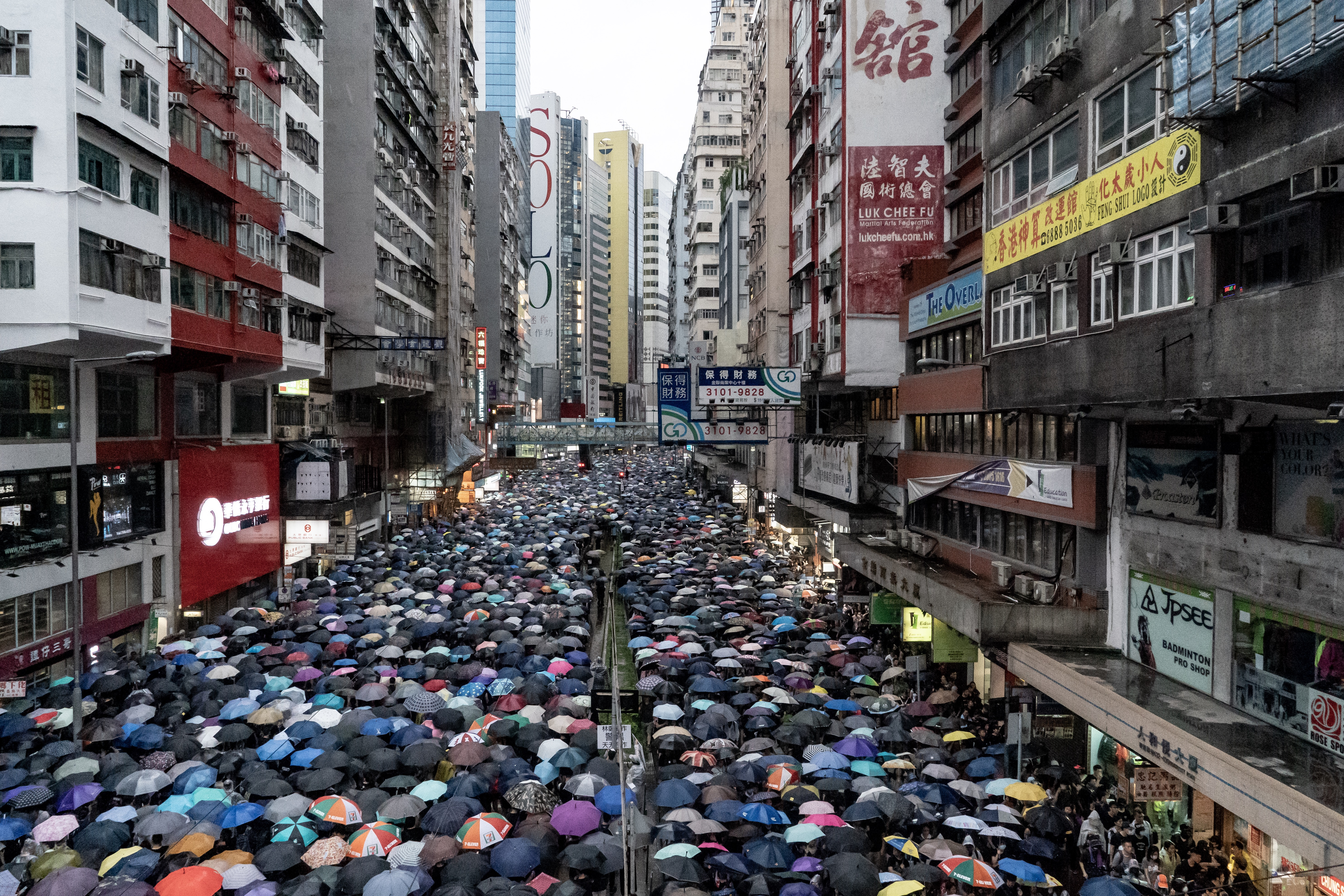 Protesters take part in a rally as they march on a street on August 18, 2019 in Hong Kong, China. (Photo by Anthony Kwan/Getty Images)
