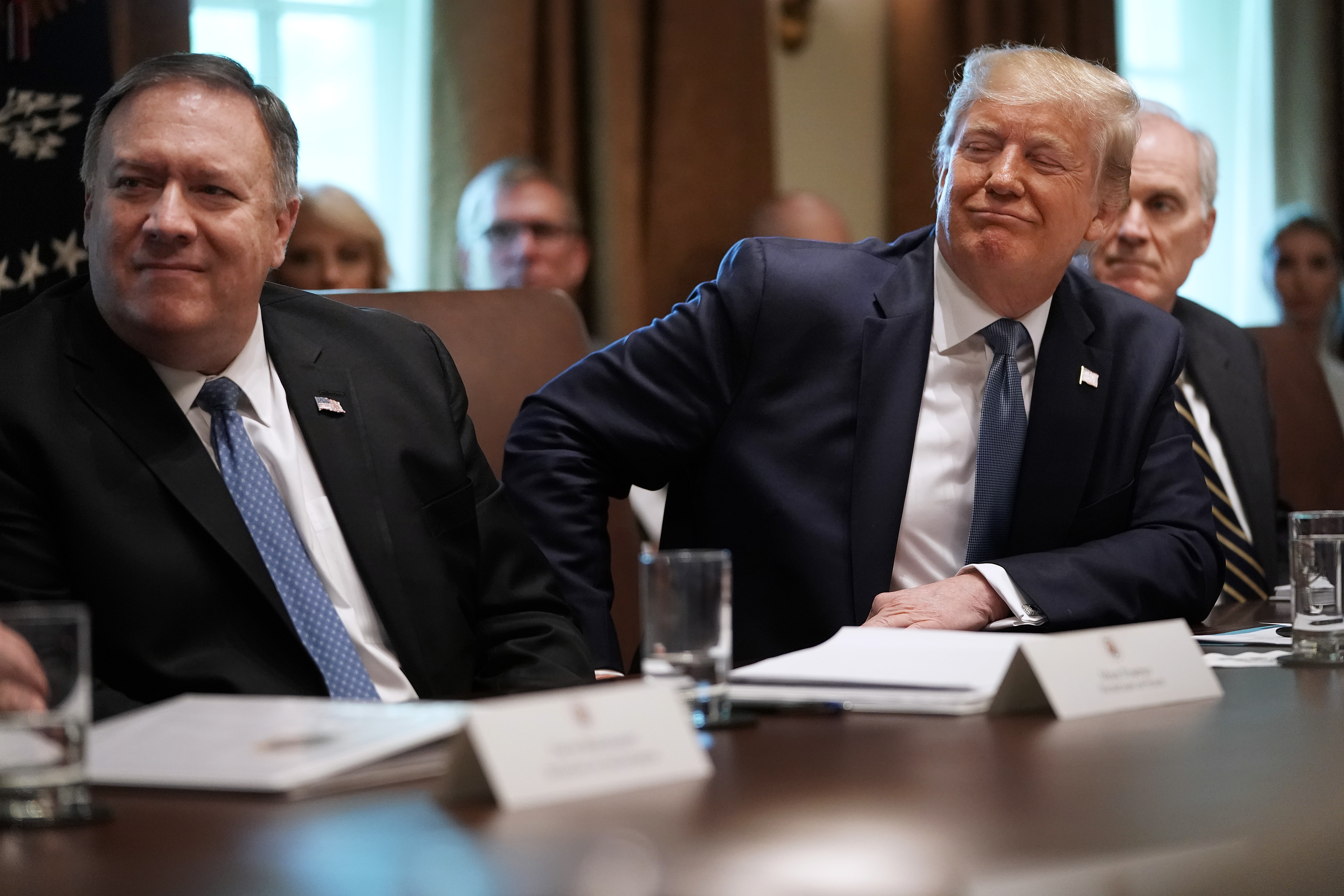 WASHINGTON, DC - JULY 16: U.S. President Donald Trump listens to a presentation about prescription drugs during a cabinet meeting with Secretary of State Mike Pompeo (L), acting Defense Secretary Richard Spencer and others at the White House July 16, 2019 in Washington, DC. Trump and members of his administration addressed a wide variety of subjects, including Iran, opportunity zones, drug prices, HIV/AIDS, immigration and other subjects for more than an hour. (Photo by Chip Somodevilla/Getty Images)