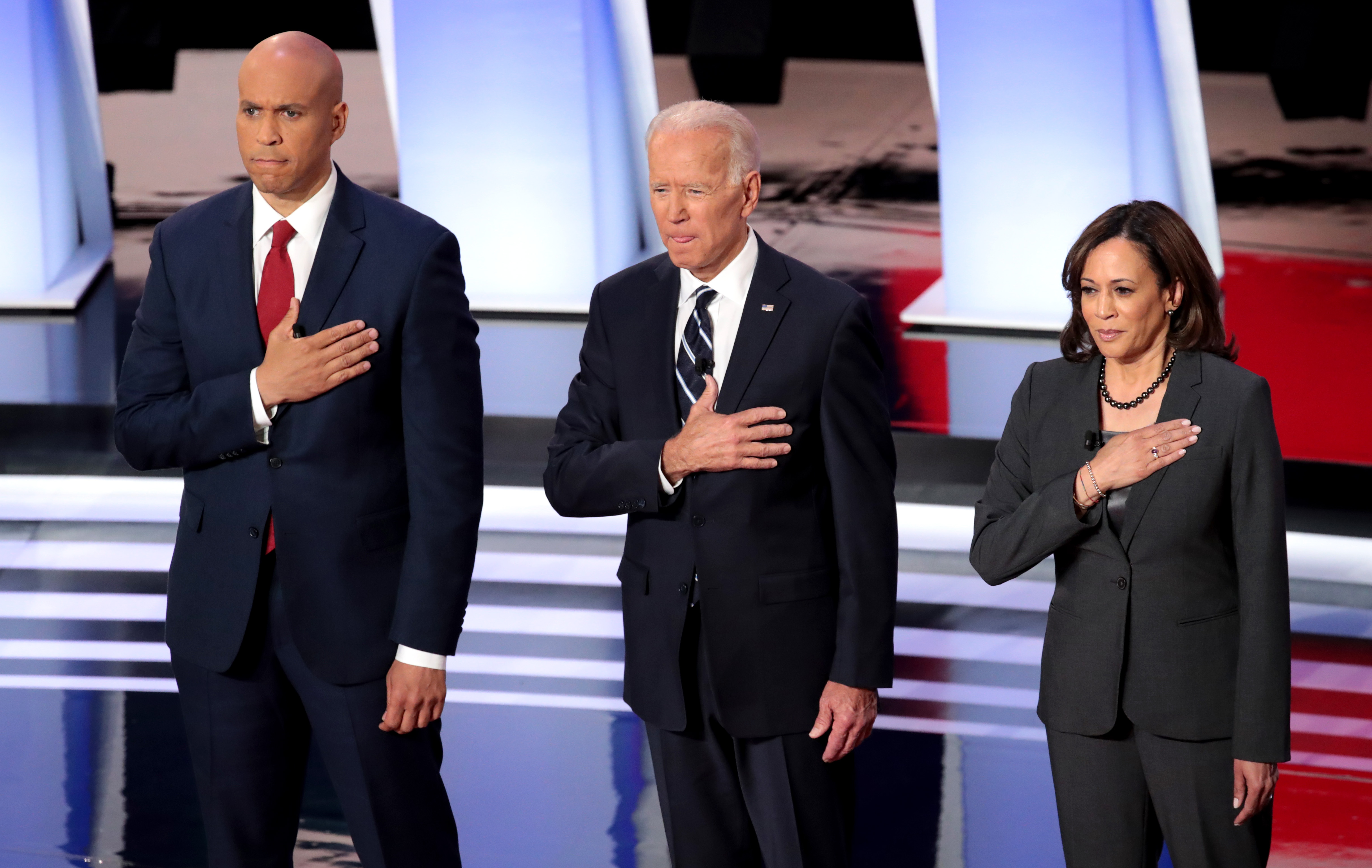 DETROIT, MICHIGAN - JULY 31: Democratic presidential candidates Sen. Cory Booker (D-NJ) (L-R), former Vice President Joe Biden, Sen. and Kamala Harris (D-CA) take the stage at the Democratic Presidential Debate at the Fox Theatre July 31, 2019 in Detroit, Michigan. 20 Democratic presidential candidates were split into two groups of 10 to take part in the debate sponsored by CNN held over two nights at Detroit's Fox Theatre. (Photo by Scott Olson/Getty Images)