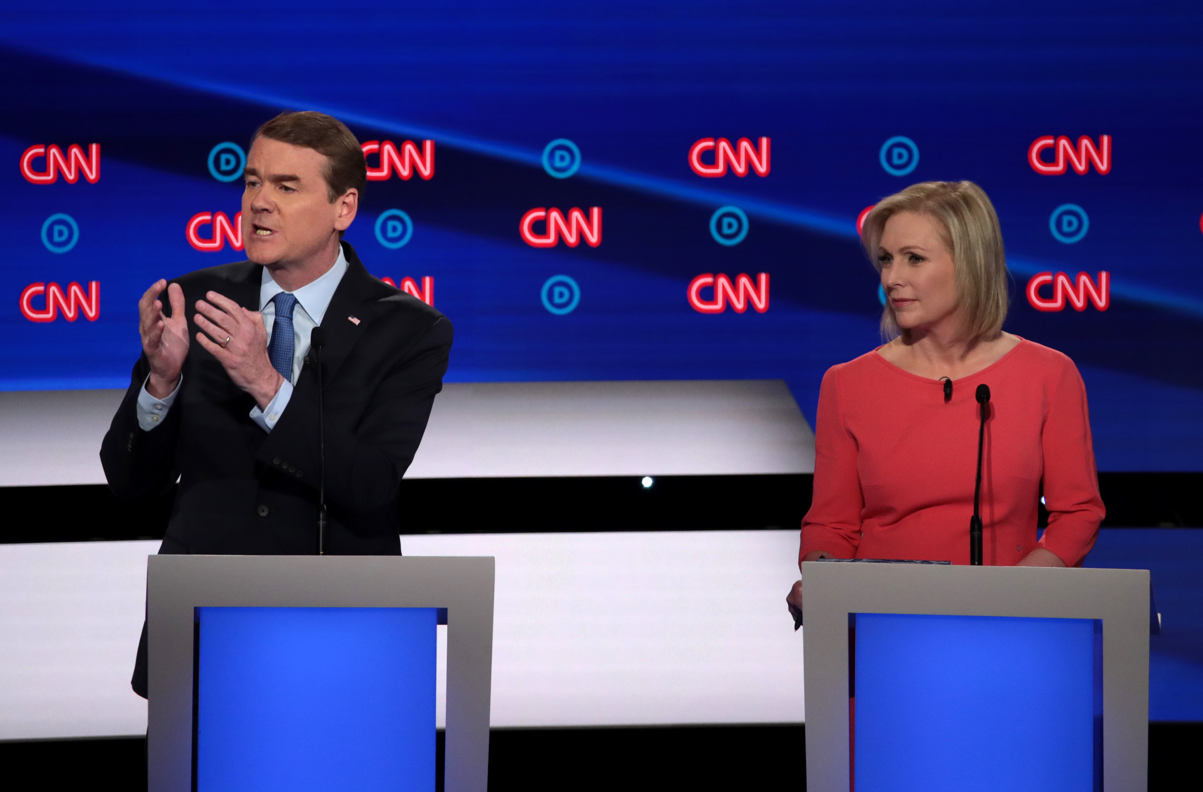DETROIT, MICHIGAN - JULY 31: Democratic presidential candidate Sen. Michael Bennet (D-CO) speaks while Sen. Kirsten Gillibrand (D-NY) listens during the Democratic Presidential Debate at the Fox Theatre July 31, 2019 in Detroit, Michigan. 20 Democratic presidential candidates were split into two groups of 10 to take part in the debate sponsored by CNN held over two nights at Detroit's Fox Theatre. (Photo by Scott Olson/Getty Images)