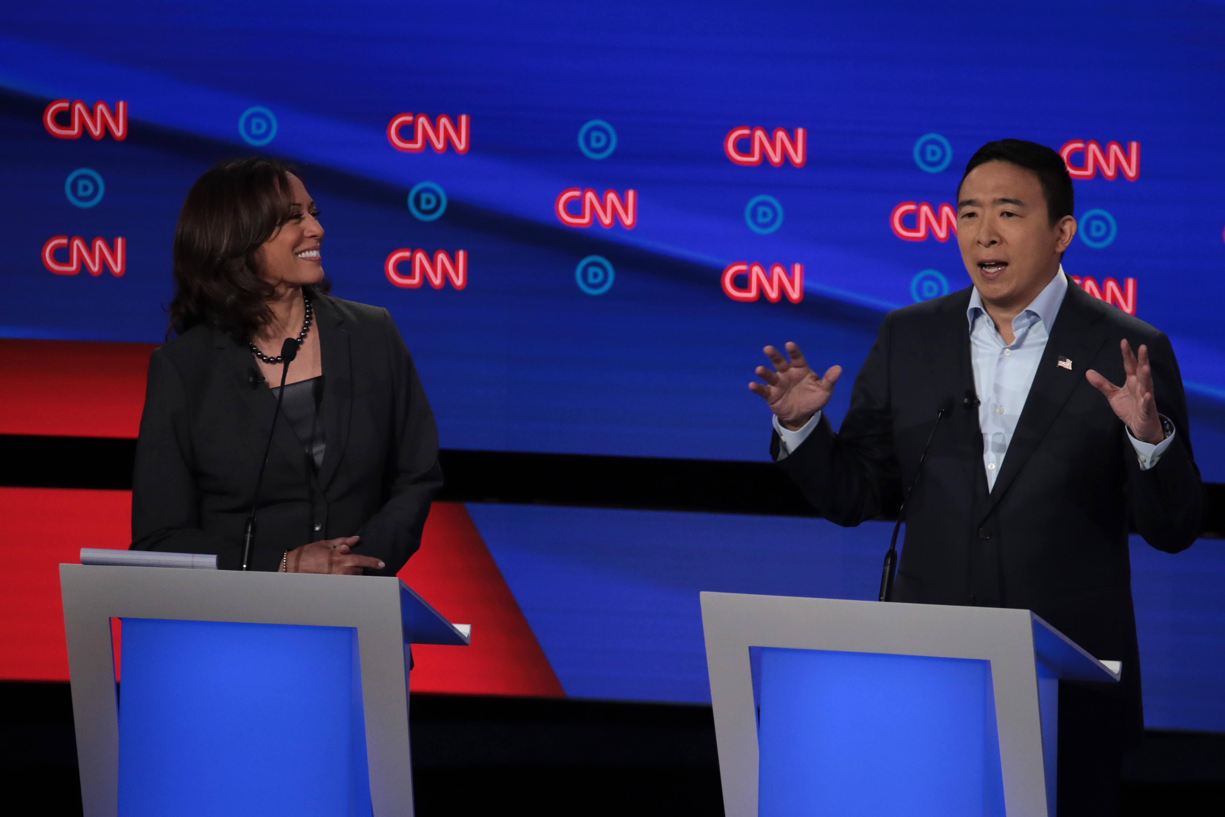 Democratic presidential candidate former tech executive Andrew Yang speaks while Sen. Kamala Harris listens at the Democratic Presidential Debate at the Fox Theatre July 31, 2019 in Detroit, Michigan. (Photo by Scott Olson/Getty Images)