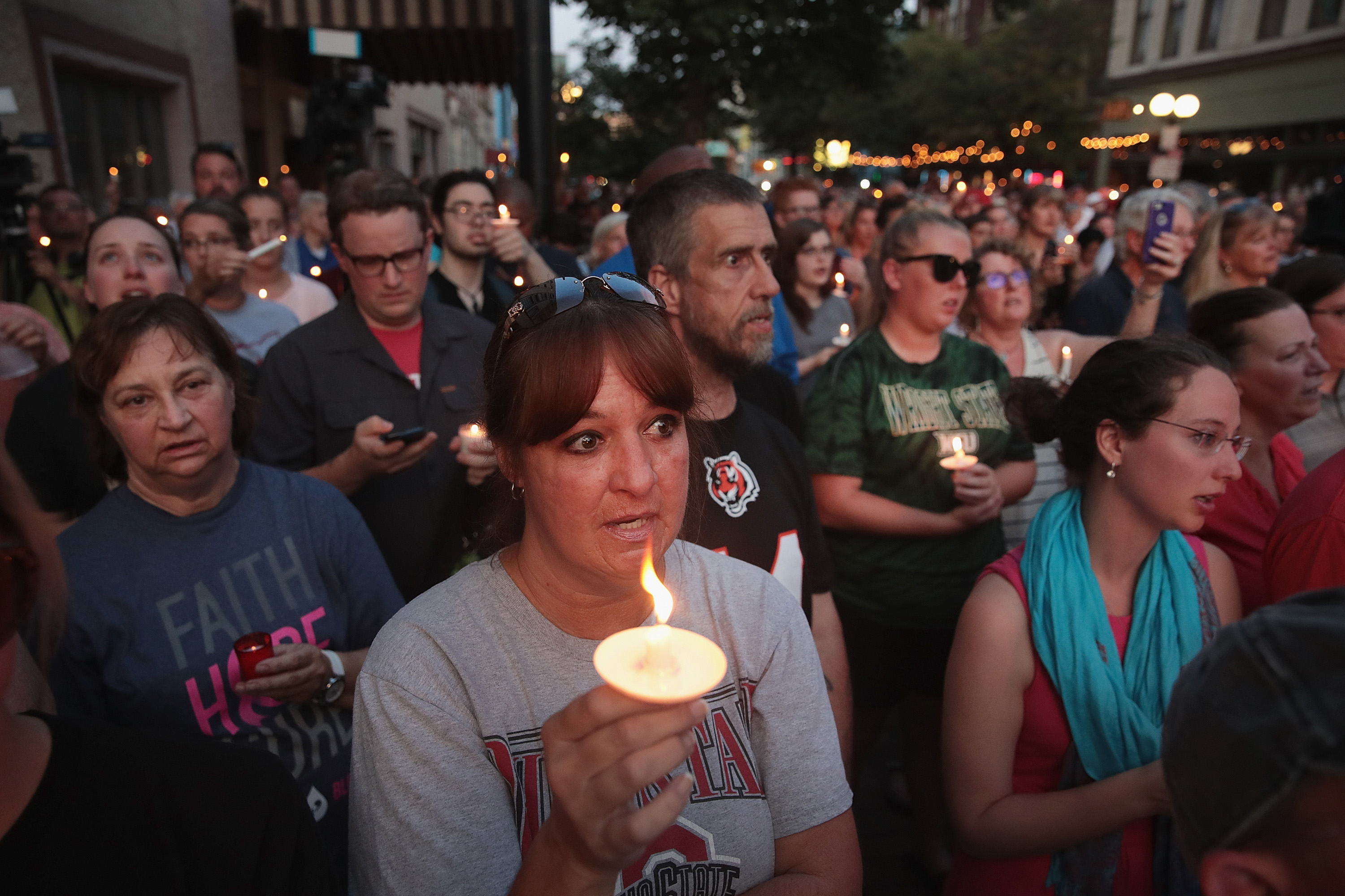 Mourners attend a memorial service in the Oregon District to recognize the victims of an early-morning mass shooting in the popular nightspot on August 04, 2019 in Dayton, Ohio. (Photo by Scott Olson/Getty Images)