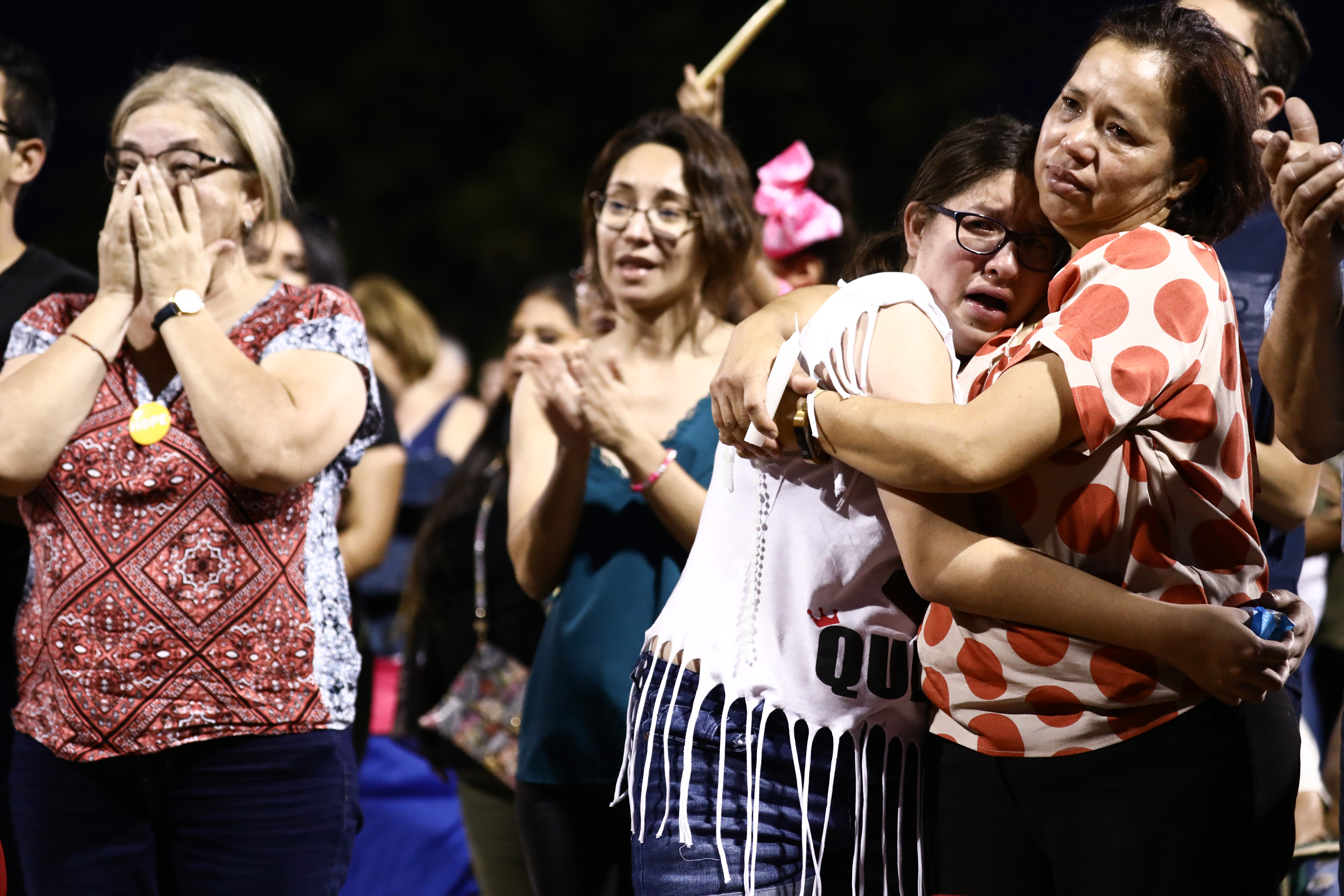 People react and embrace each other during an interfaith vigil for victims of a mass shooting which left at least 20 people dead, on August 4, 2019 in El Paso, Texas (Mario Tama/Getty Images)