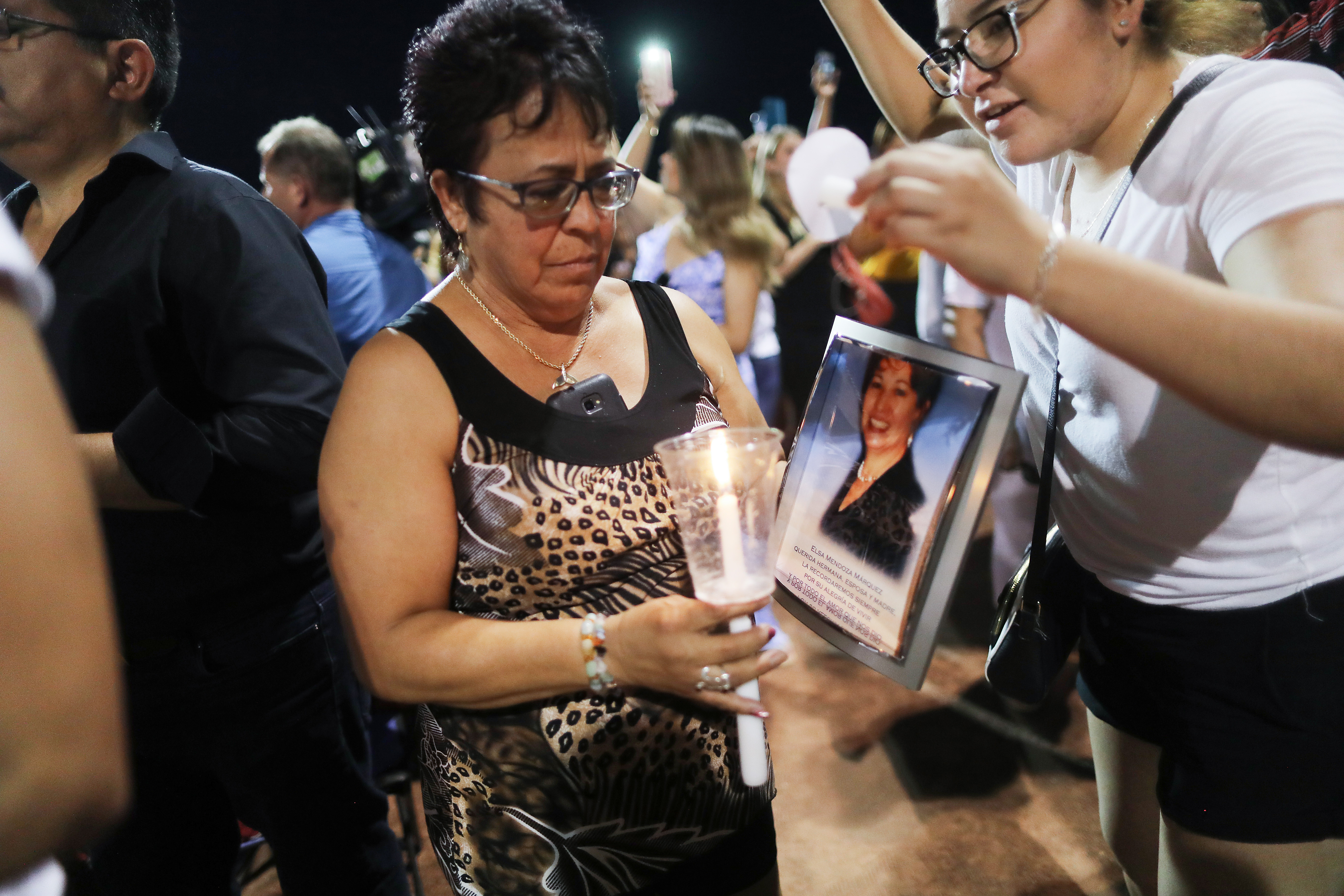 Lupe Lopez carries a photo Elsa Mendoza Marquez, a Mexican schoolteacher from Ciudad Juarez who was killed in the shooting, during an interfaith vigil for victims of a mass shooting which left at least 20 people dead, on August 4, 2019 in El Paso, Texas. (Photo by Mario Tama/Getty Images)