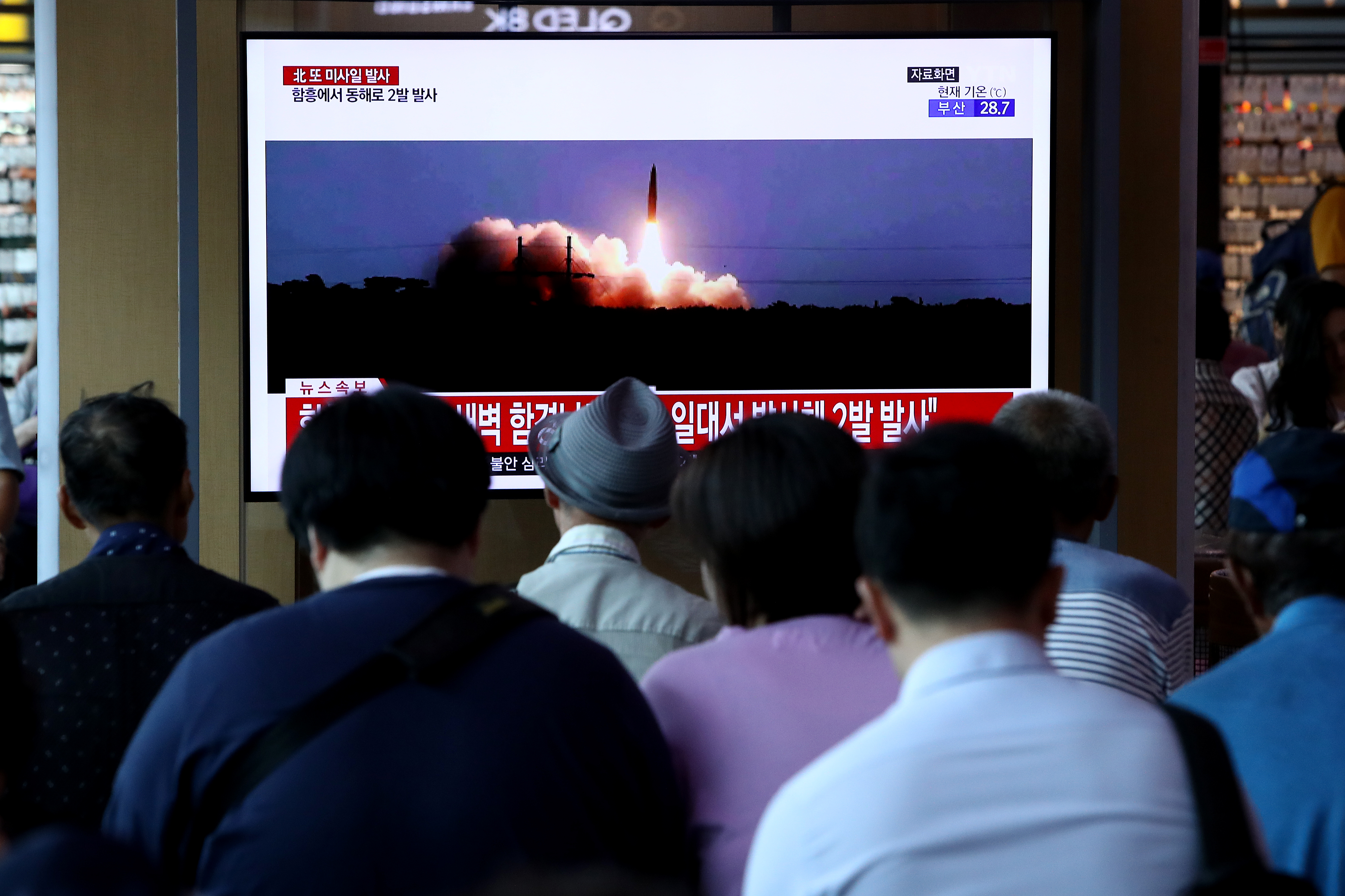 People watch a TV showing a file image of a North Korean missile launch at the Seoul Railway Station on August 10, 2019 in Seoul, South Korea. (Photo by Chung Sung-Jun/Getty Images)