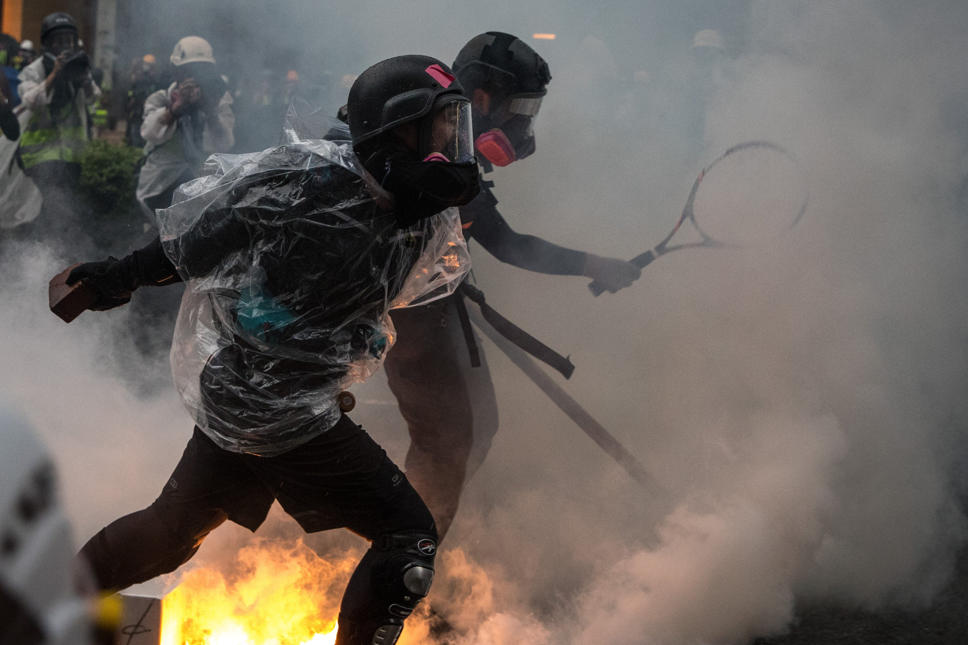 Protesters clash with police after an anti-government rally in Tsuen Wan district on August 25, 2019 in Hong Kong, China. Pro-democracy protesters have continued rallies on the streets of Hong Kong against a controversial extradition bill since 9 June as the city plunged into crisis after waves of demonstrations and several violent clashes. (Photo by Chris McGrath/Getty Images)
