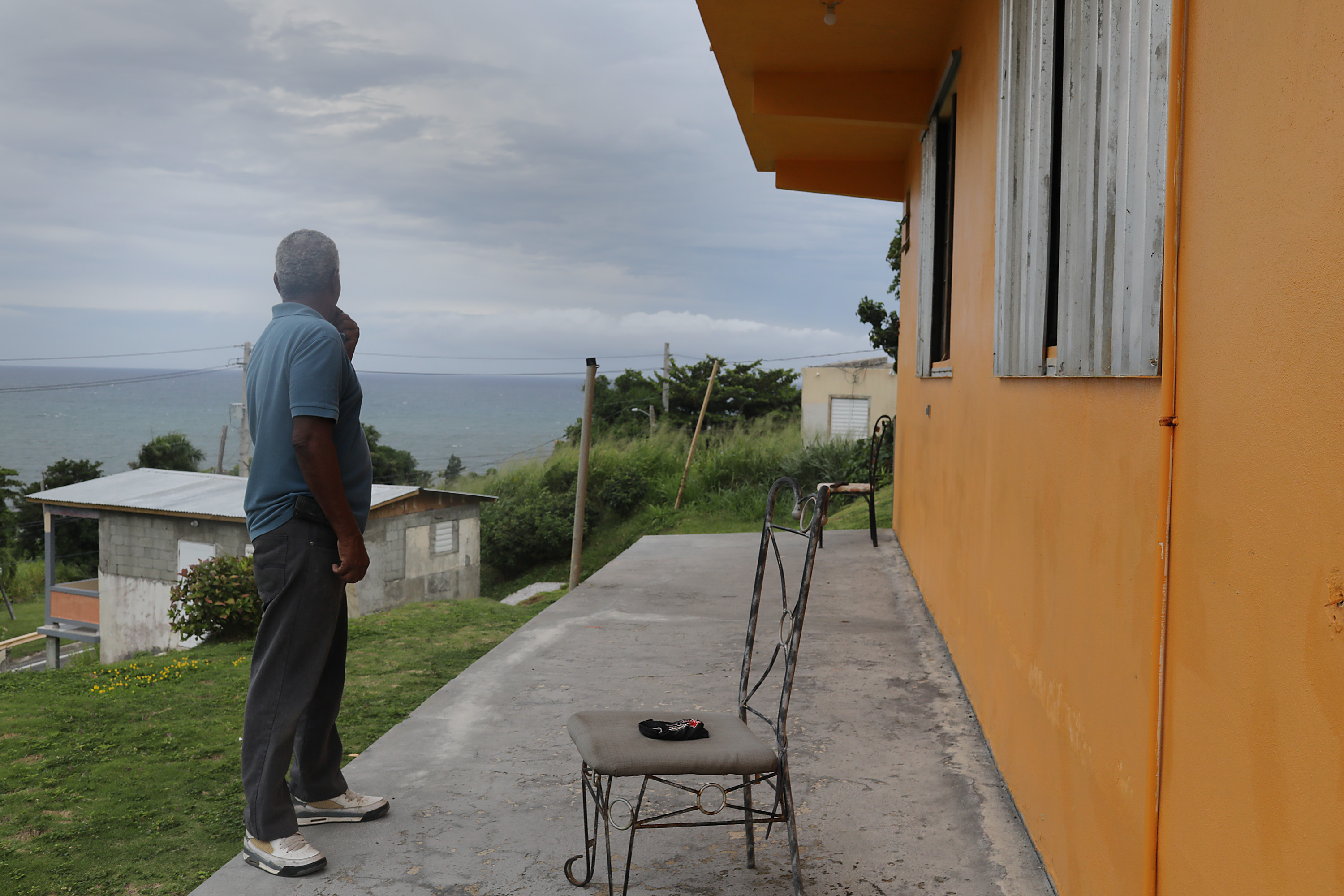 Zollo Azea puts shutters over the windows of his home as he prepares for the arrival of Tropical Storm Dorian on August 28, 2019 in Yabucoa, Puerto Rico. (Joe Raedle/Getty Images)