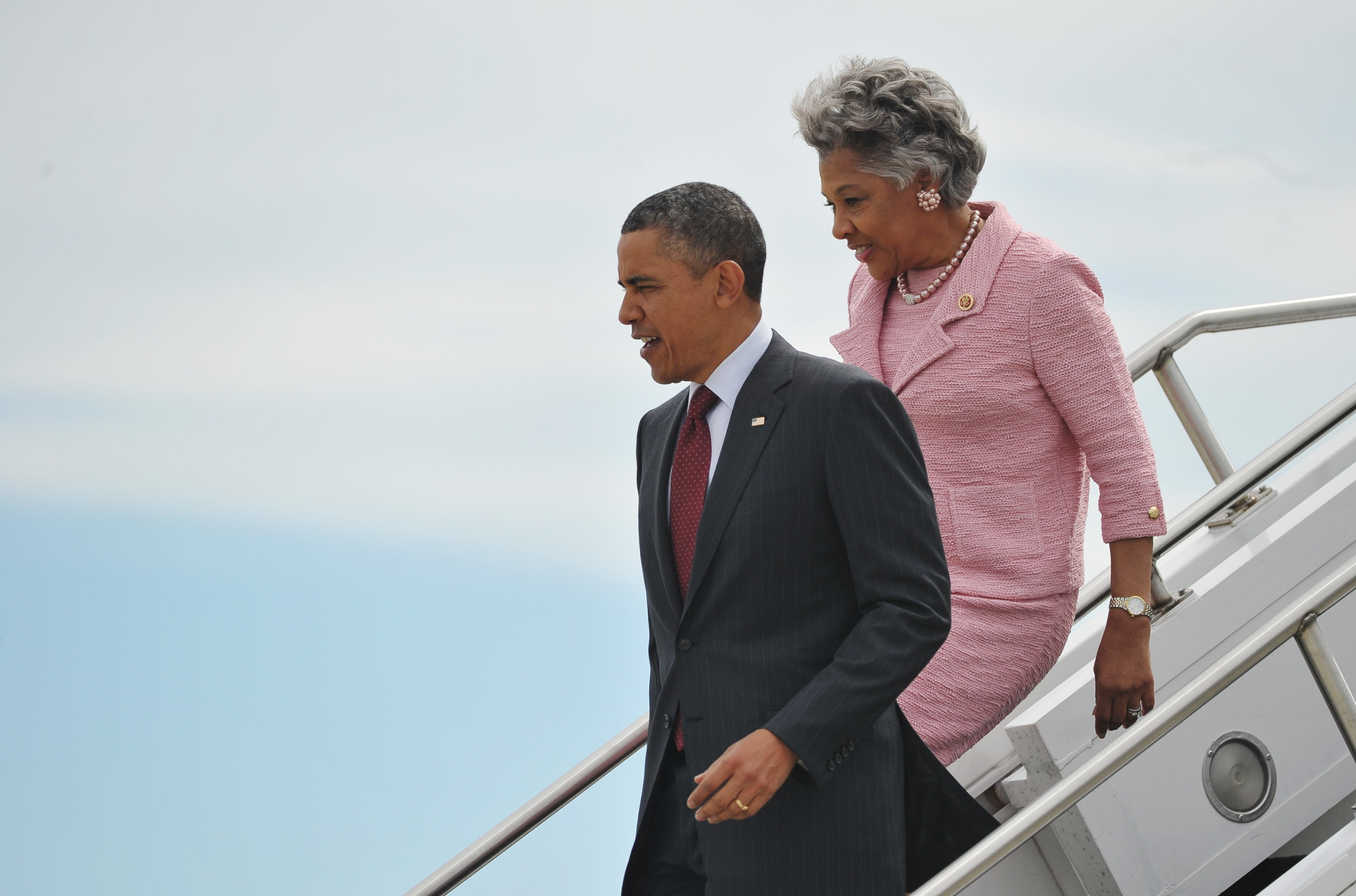 US President Barack Obama steps off Air Force One with Rep. Joyce Beatty on May 5, 2013 upon arrival at Rickenbacker International Airport in Columbus, Ohio. Obama is in Columbus to deliver the commencement address at Ohio State University. (MANDEL NGAN/AFP/Getty Images)
