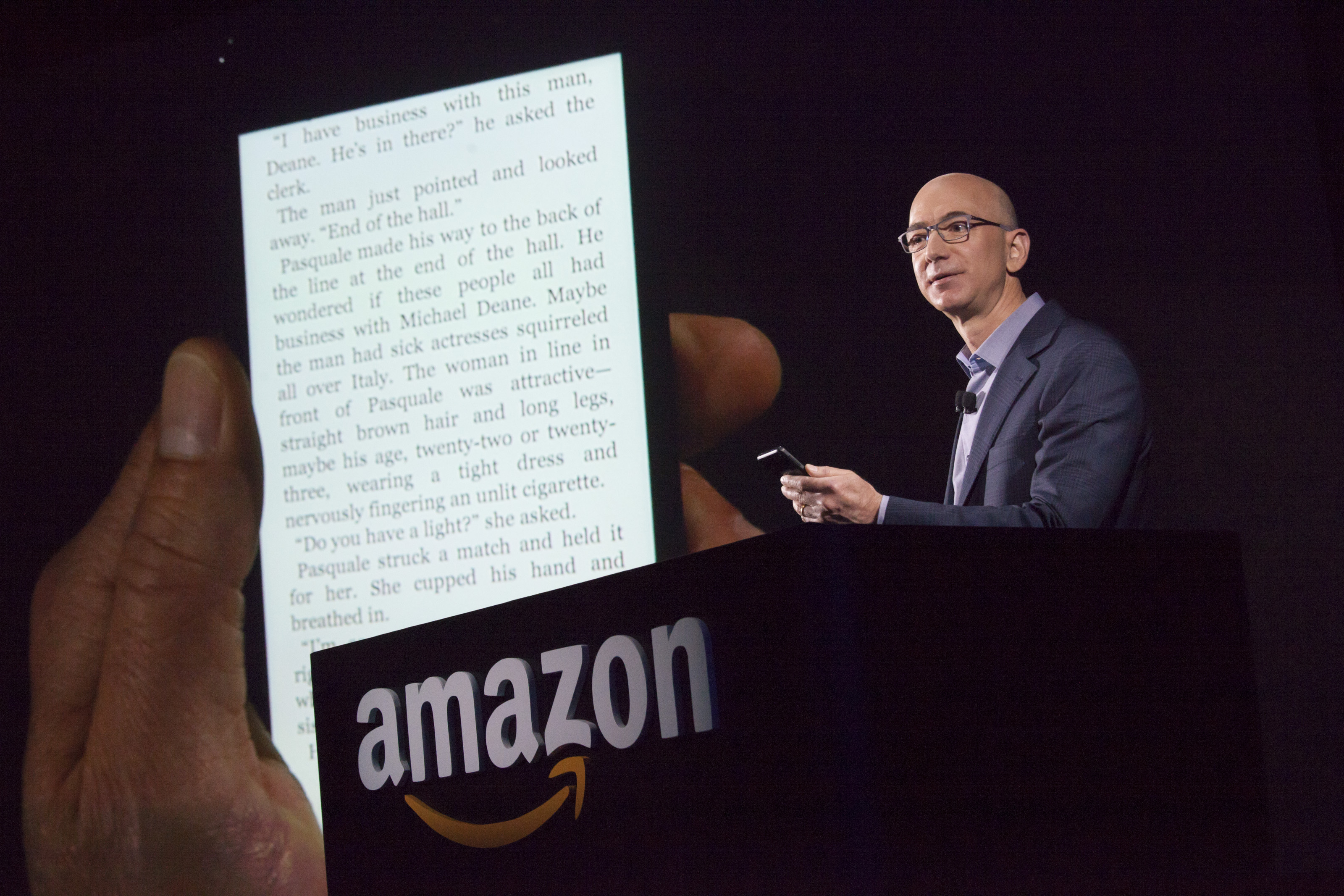Amazon.com founder and CEO Jeff Bezos demonstrates the company's first smartphone, the Fire Phone, on June 18, 2014 in Seattle, Washington. The much-anticipated device is available for pre-order today and is available exclusively with AT&T service. (Photo by David Ryder/Getty Images)