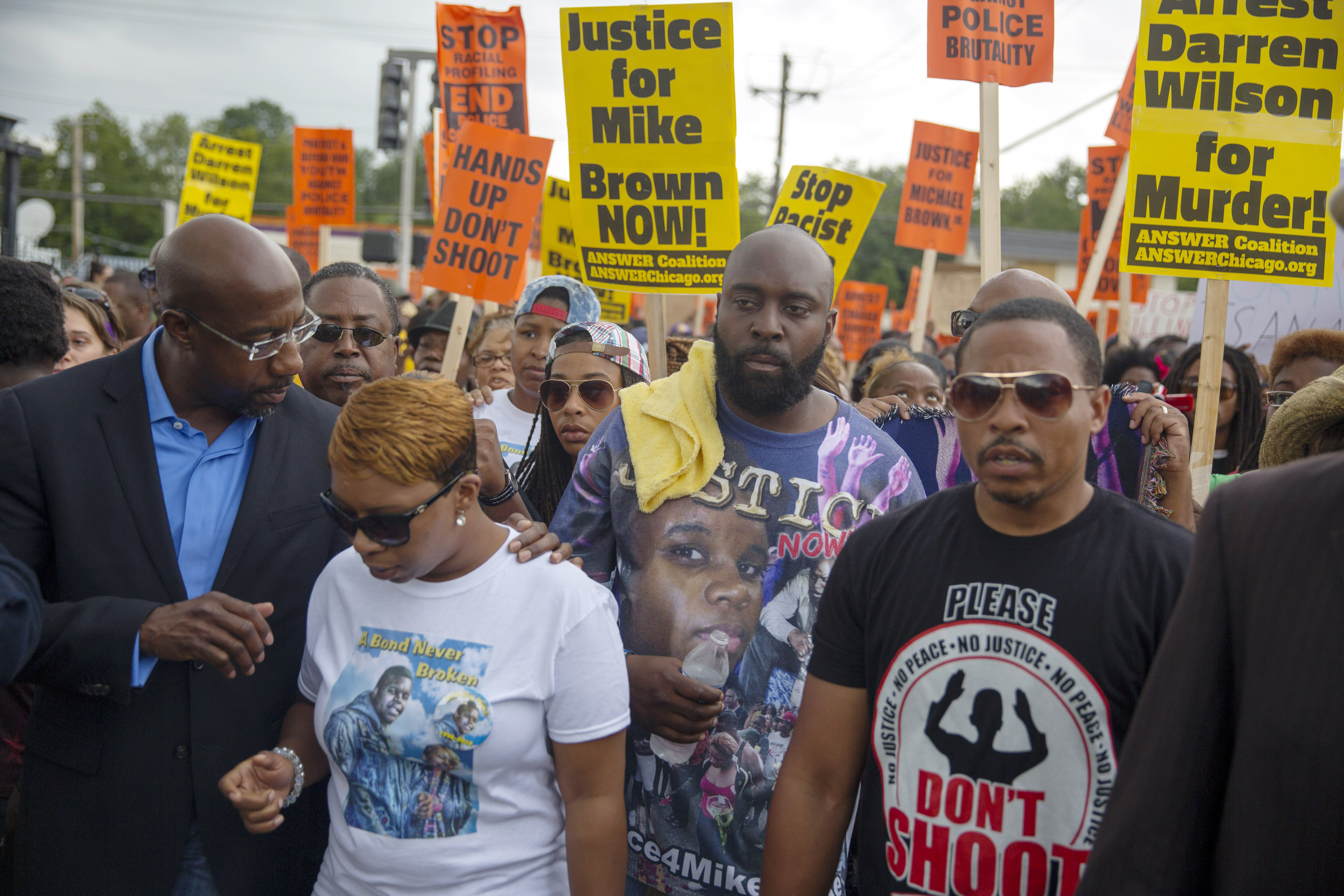 Lesley McSpadden (2L) and Michael Brown Sr. (C), parents of Michael Brown, march in a protest for their son on August 30, 2014 in Ferguson, Missouri. (Aaron P. Bernstein/Getty Images)