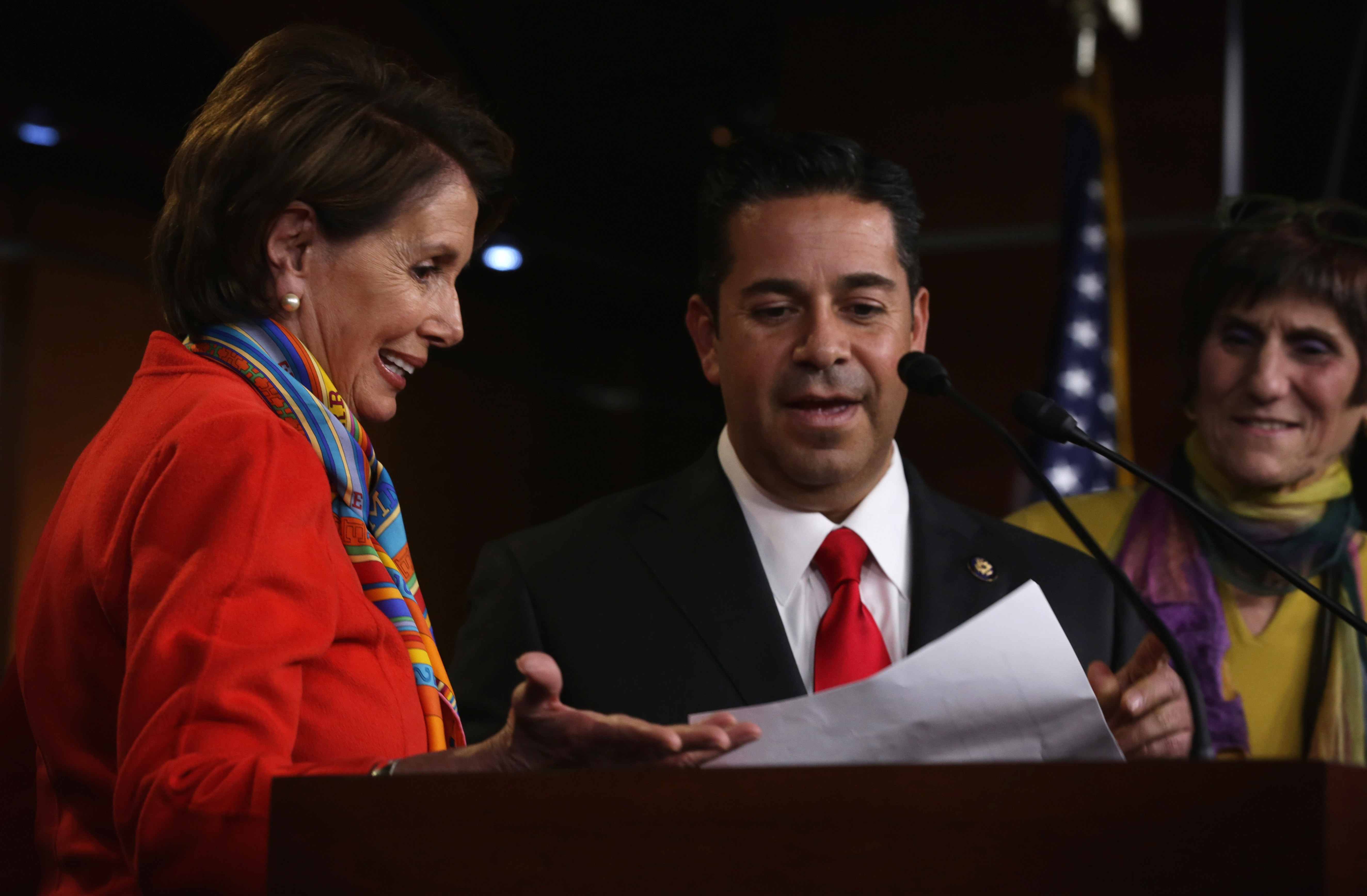 U.S. House Minority Leader Rep. Nancy Pelosi (D-CA) (L) yields to Rep. Ben Ray Luján (D-NM) during a news conference to announce new members of the House Democratic leadership team. (Photo by Alex Wong/Getty Images)