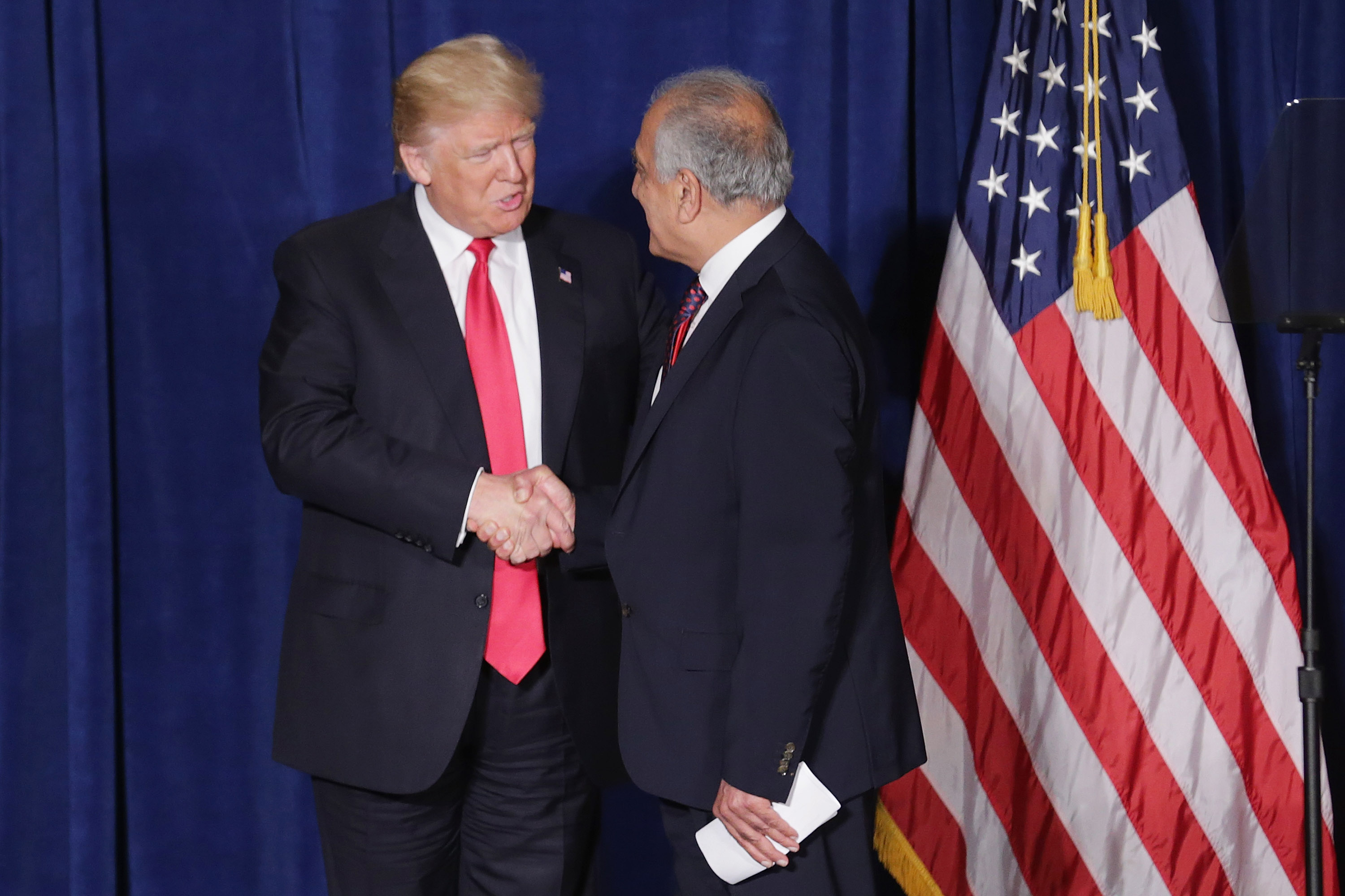 Republican presidential candidate Donald Trump (L) is welcomed to the stage by former U.S. Ambassador to Iraq and Afghanistan Zalmay Khalilzad at the Mayflower Hotel April 27, 2016 in Washington, DC. (Photo by Chip Somodevilla/Getty Images)