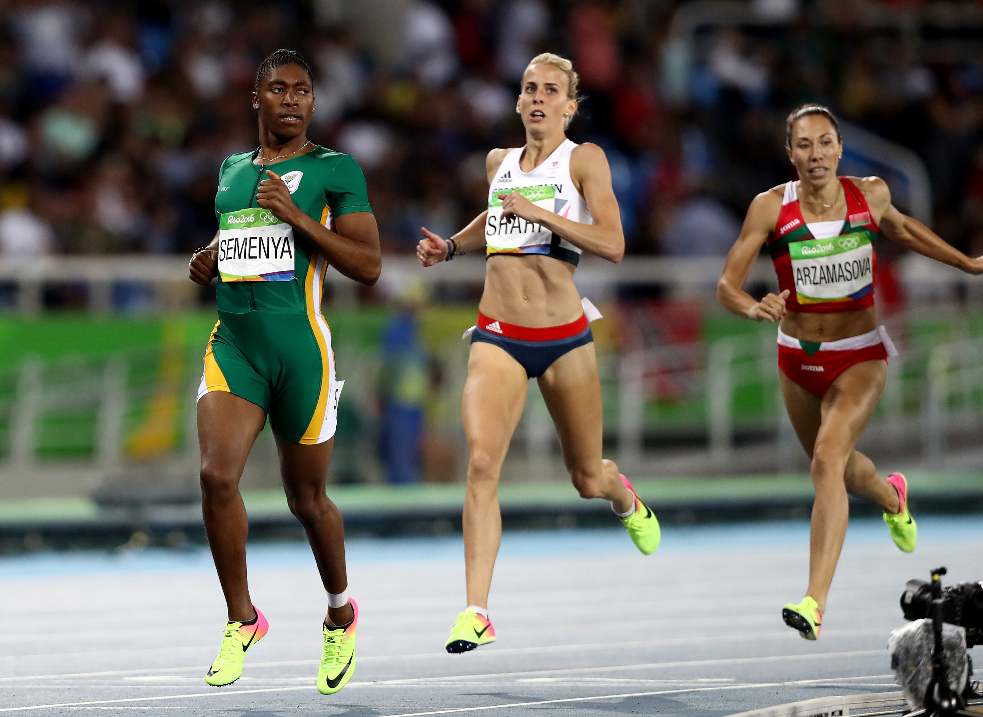 RIO DE JANEIRO, BRAZIL - AUGUST 18: Caster Semenya of South Africa and Lynsey Sharp of Great Britain compete in the Women's 800m Semifinals on Day 13 of the Rio 2016 Olympic Games at the Olympic Stadium on August 18, 2016 in Rio de Janeiro, Brazil. (Photo by Ezra Shaw/Getty Images)