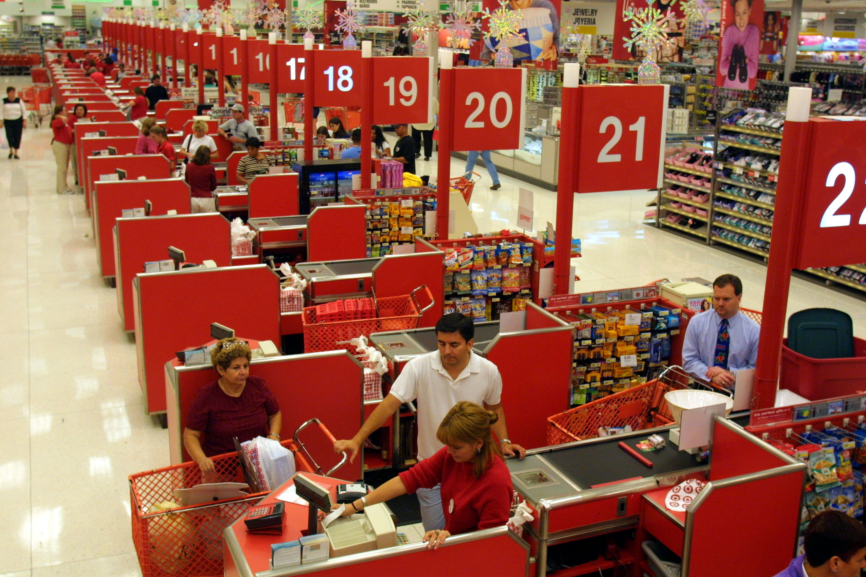 Shoppers purchase their items at the checkout counter in the Target department store at Sawgrass Mills Shopping Center November 19, 2001 in Sunrise, Florida. (Photo by Joe Raedle/Getty Images)