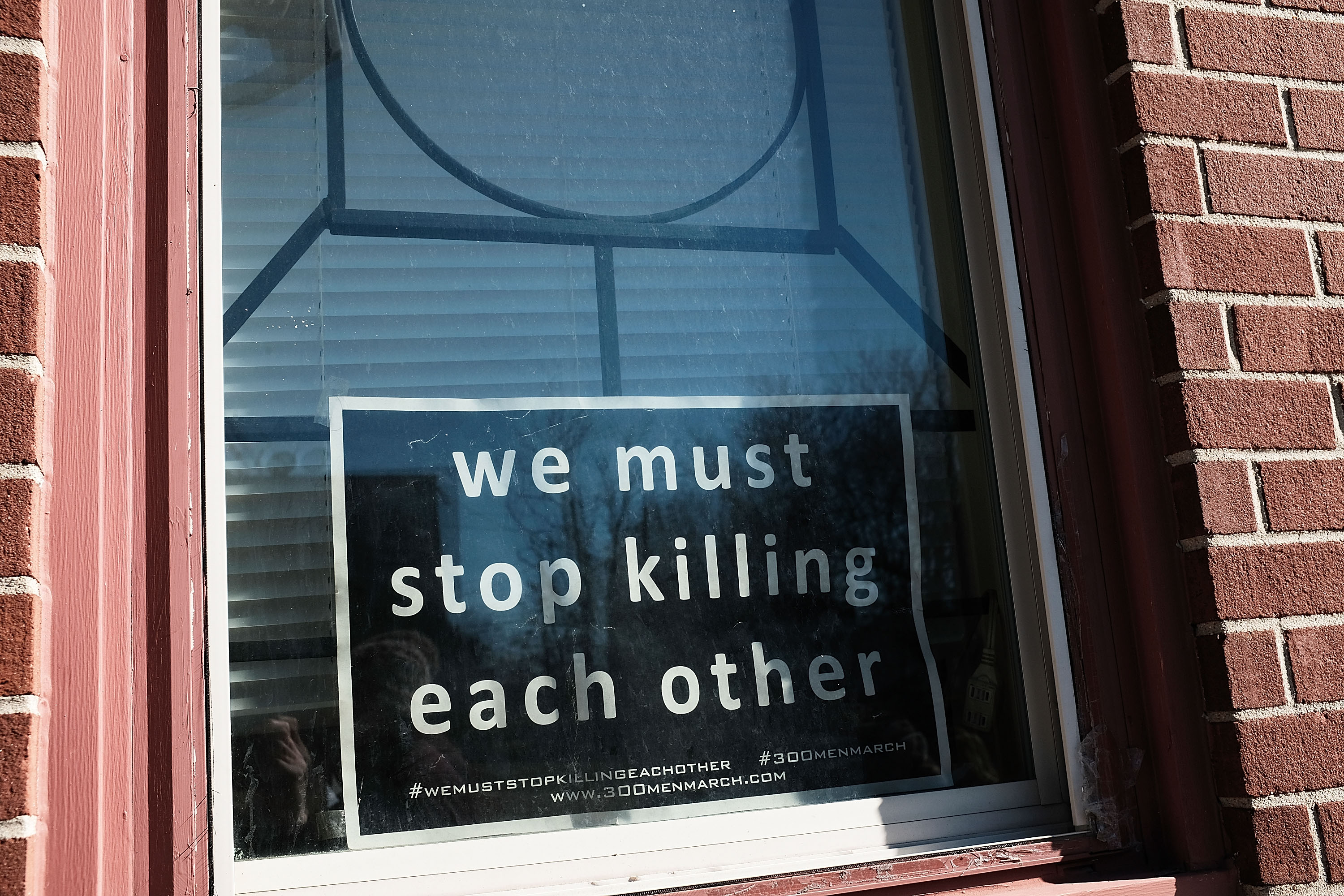 BALTIMORE, MD - FEBRUARY 03: A sign to end violence sits in a window in a neighborhood with a high murder rate on February 3, 2018 in Baltimore, Maryland. Baltimore, one of the poorest major cities in the United States, experienced 341 homicides last year, the highest per-capita rate on record for the city. The third citywide Ceasefire event began on Friday, with organizers and community members calling for peace for a 72-hour period and holding numerous events, including peace walks, movie screenings and a youth basketball tournament among other gatherings. (Photo by Spencer Platt/Getty Images)
