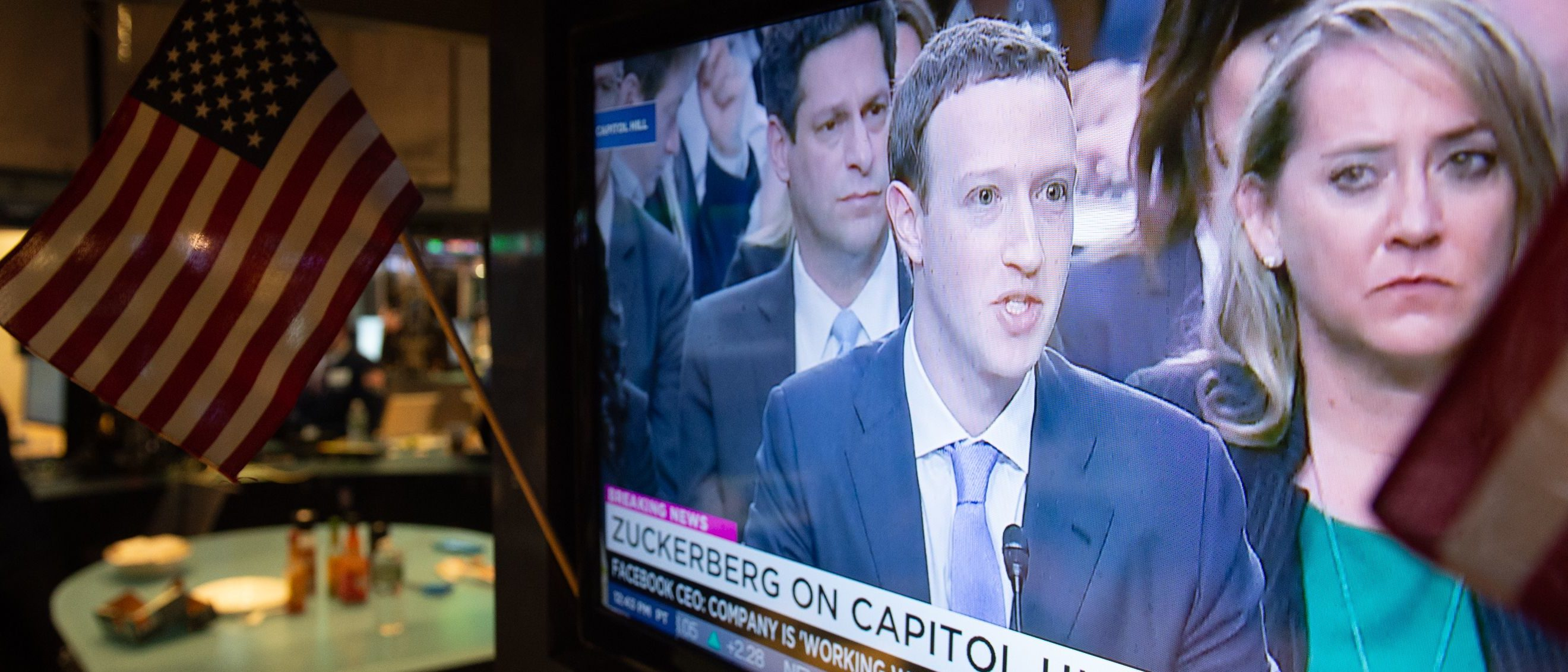 A broadcast of Facebook CEO Mark Zuckerberg testifying on Capital Hill is televised on the floor at the closing bell of the Dow Industrial Average at the New York Stock Exchange on April 10, 2018 in New York. / AFP PHOTO / Bryan R. Smith (Photo credit should read BRYAN R. SMITH/AFP/Getty Images)