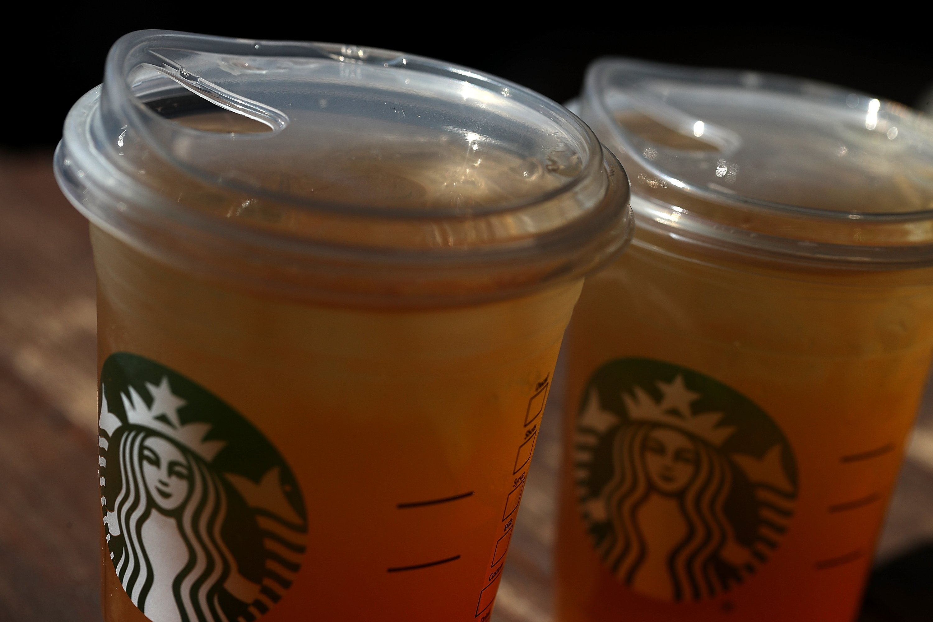 A new flat plastic lid that does not need a straw is shown on a cup of Starbucks iced tea on July 9, 2018 in Sausalito, California. Starbucks announced today that it plans on phasing out all plastic straws from its 28,000 stores worldwide by 2020. Some of its drinnk cups will be fitted with special flat plastic lids that can be used without straws. (Photo by Justin Sullivan/Getty Images)