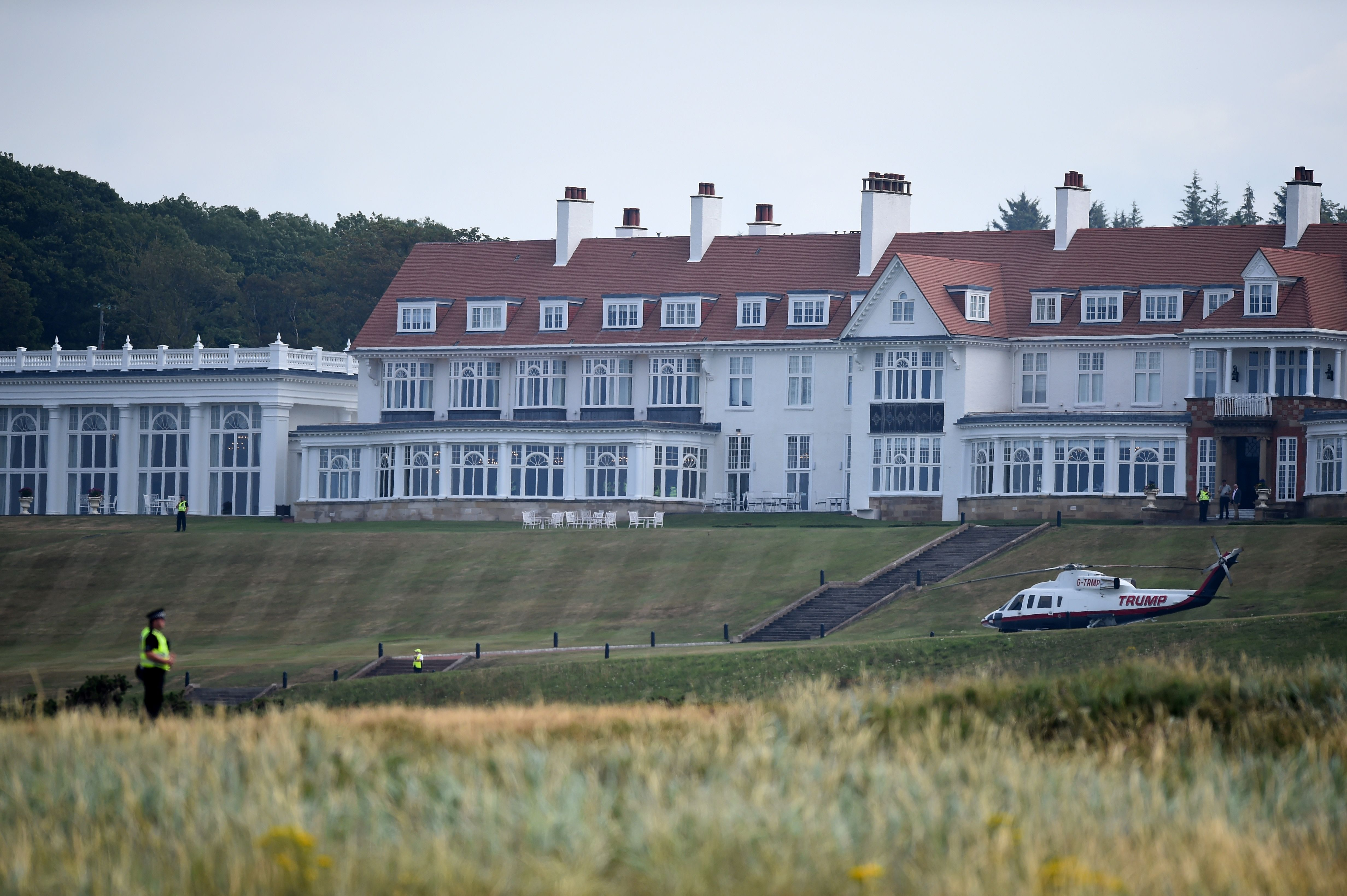 Police offficers stand guard at Trump Turnberry, the luxury golf resort of US President Donald Trump, in Turnberry, southwest of Glasgow, Scotland on July 14, 2018, during the private part of his four-day UK visit. - US President Donald Trump wraps up a four-day visit to Britain, dominated by his blasting of Prime Minister Theresa May's Brexit strategy, by spending the weekend in Scotland. (Photo by ANDY BUCHANAN/AFP/Getty Images)