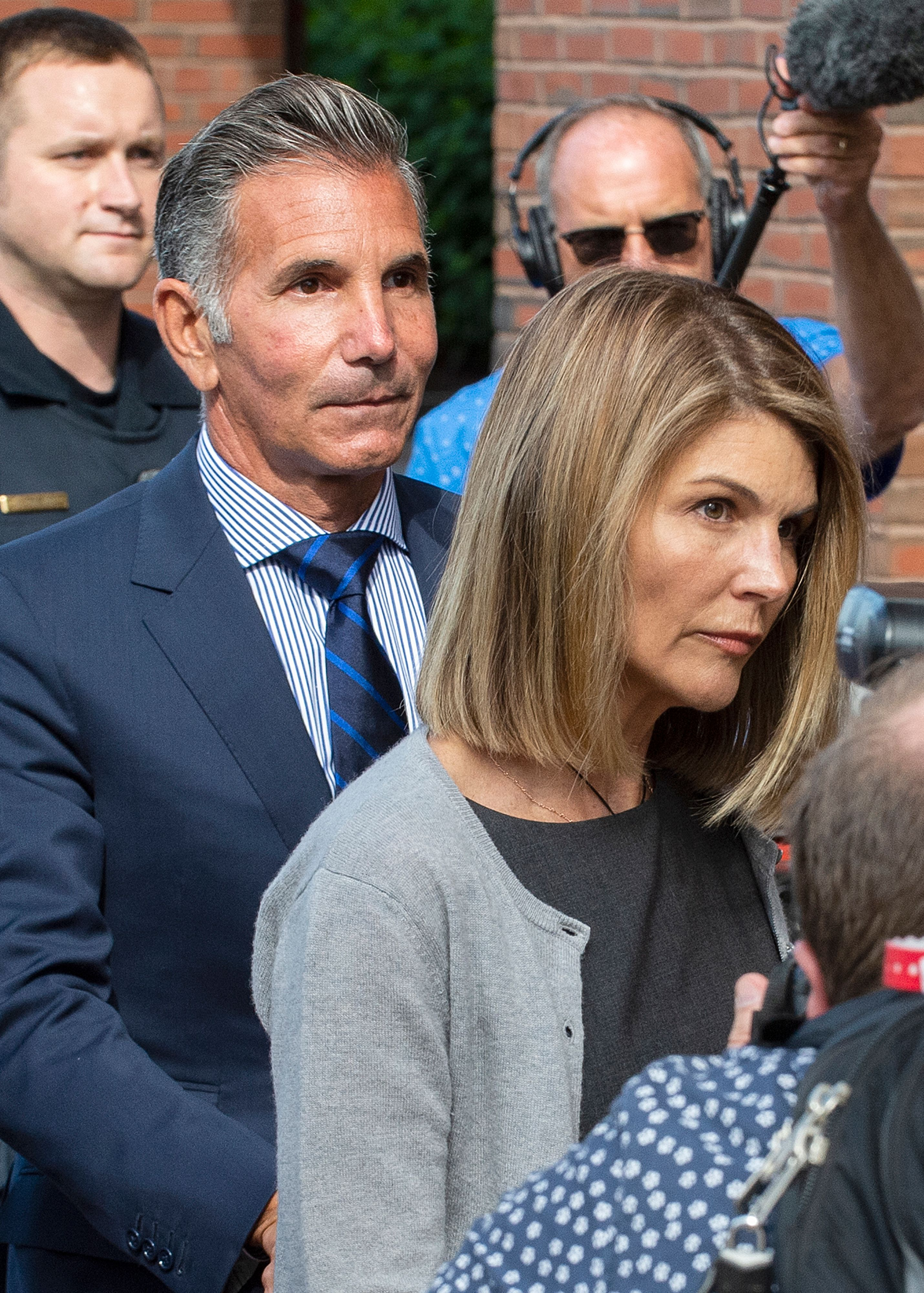 Actress Lori Loughlin (R) and husband Mossimo Giannulli exit the Boston Federal Court house after a pre-trial hearing with Magistrate Judge Kelley at the John Joseph Moakley US Courthouse in Boston on August 27, 2019. - Loughlin and Giannulli are charged with conspiracy to commit mail and wire fraud and conspiracy to commit money laundering in the college admissions scandal. (Photo credit JOSEPH PREZIOSO/AFP/Getty Images)