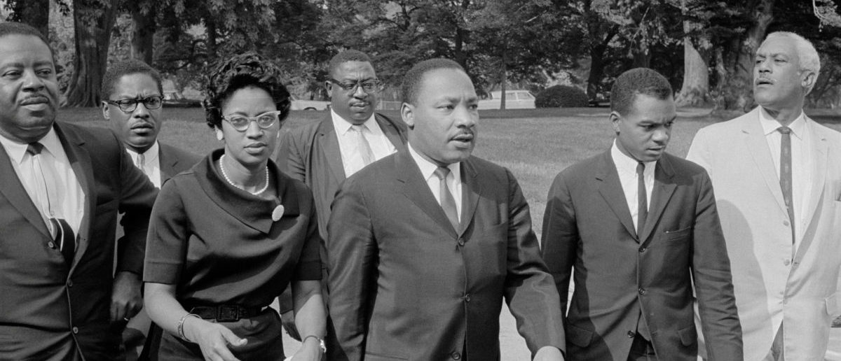 Martin Luther King Jr. (3rd R) is seen in an unknown location on August 5, 1965, a day before President Lyndon B. Johnson signed the Voting Rights Act into law. [Library of Congress/Marion S. Trikosko/Handout via REUTERS]