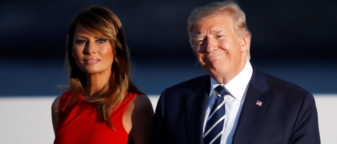 Melania Dazzles In Gorgeous Sleeveless Red Dress During France Trip