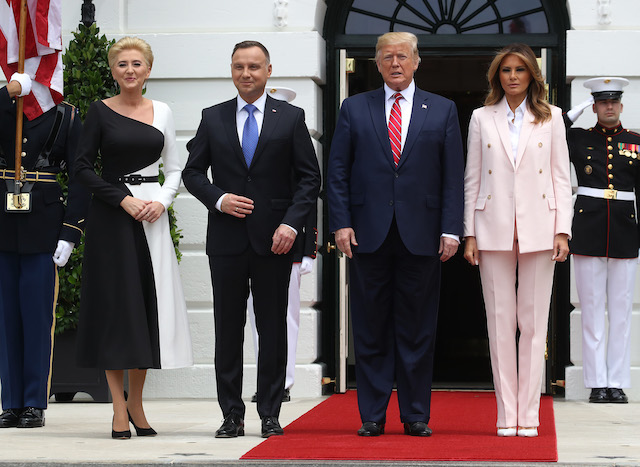 U.S. President Donald Trump and first lady Melania Trump welcome the President of Poland, Andrzej Duda and his wife Agata Kornhauser-Duda, after their arrival at the South Portico of the White House on June 12, 2019 in Washington, DC. The two leaders are scheduled to attends meetings at the White House before speaking at a Rose Garden news conference. (Photo by Mark Wilson/Getty Images)