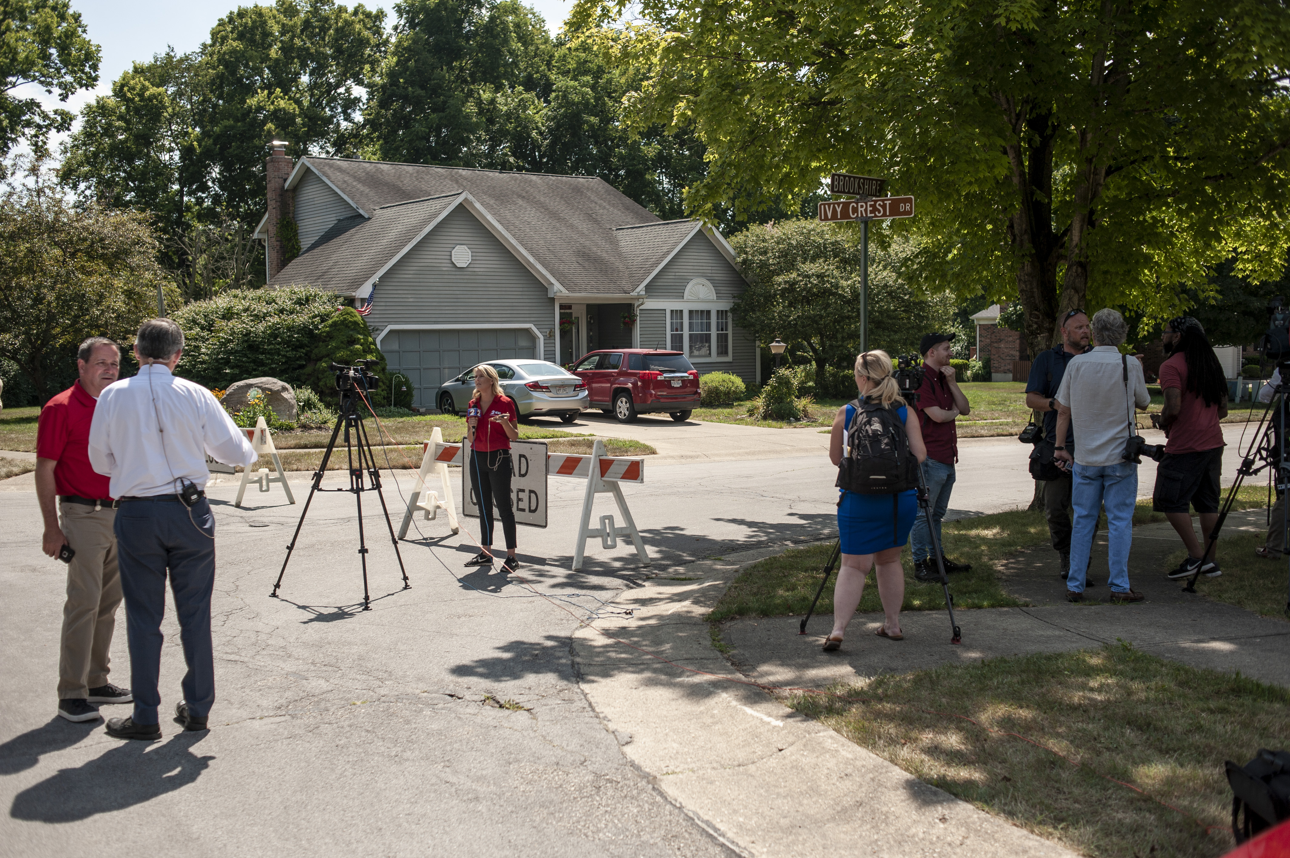 BELLBROOK, OH - AUGUST 4: Media crews gather near the street where the suspect in a mass shooting is believed to have a residence on August 4, 2019 in Bellbrook, Ohio. (Photo by Matthew Hatcher/Getty Images).