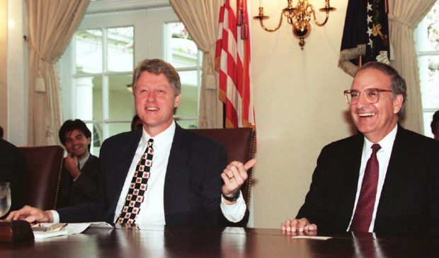 WASHINGTON, : US President Bill Clinton (L) shares a light moment, 12 April 1994, with Senate Majority Leader George Mitchell (R) prior to meetings in the Cabinet Room at the White House. Mitchell reportedly dropped out of contention for the US Supreme Court seat. (LUKE FRAZZA/AFP/Getty Images)